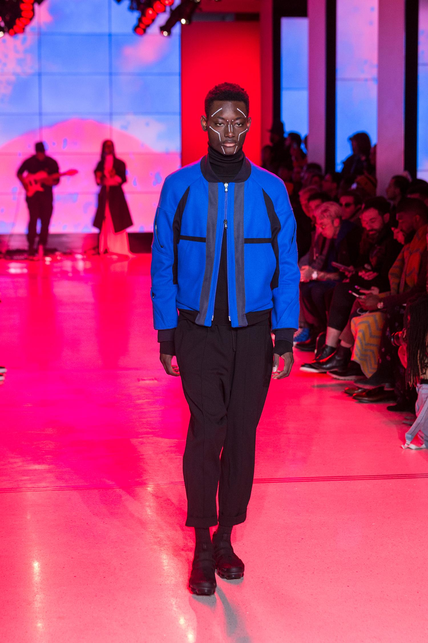 LOOK 26   ARC Flight Jacket  / Azure Blue   ARC Turtleneck  / Black Terry   ARC Ankara Pant  / Black Wool   Nike Air VaporMax Utility   .