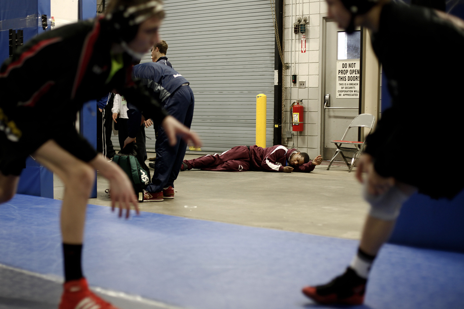 Joseph Chatman from Detroit, Divison 2, 189 pound weight class, center, rests before taking the floor at the state of Michigan Wrestling Championships on Saturday, Mar. 2, 2013 at The Palace of Auburn Hills.  TIM GALLOWAY
