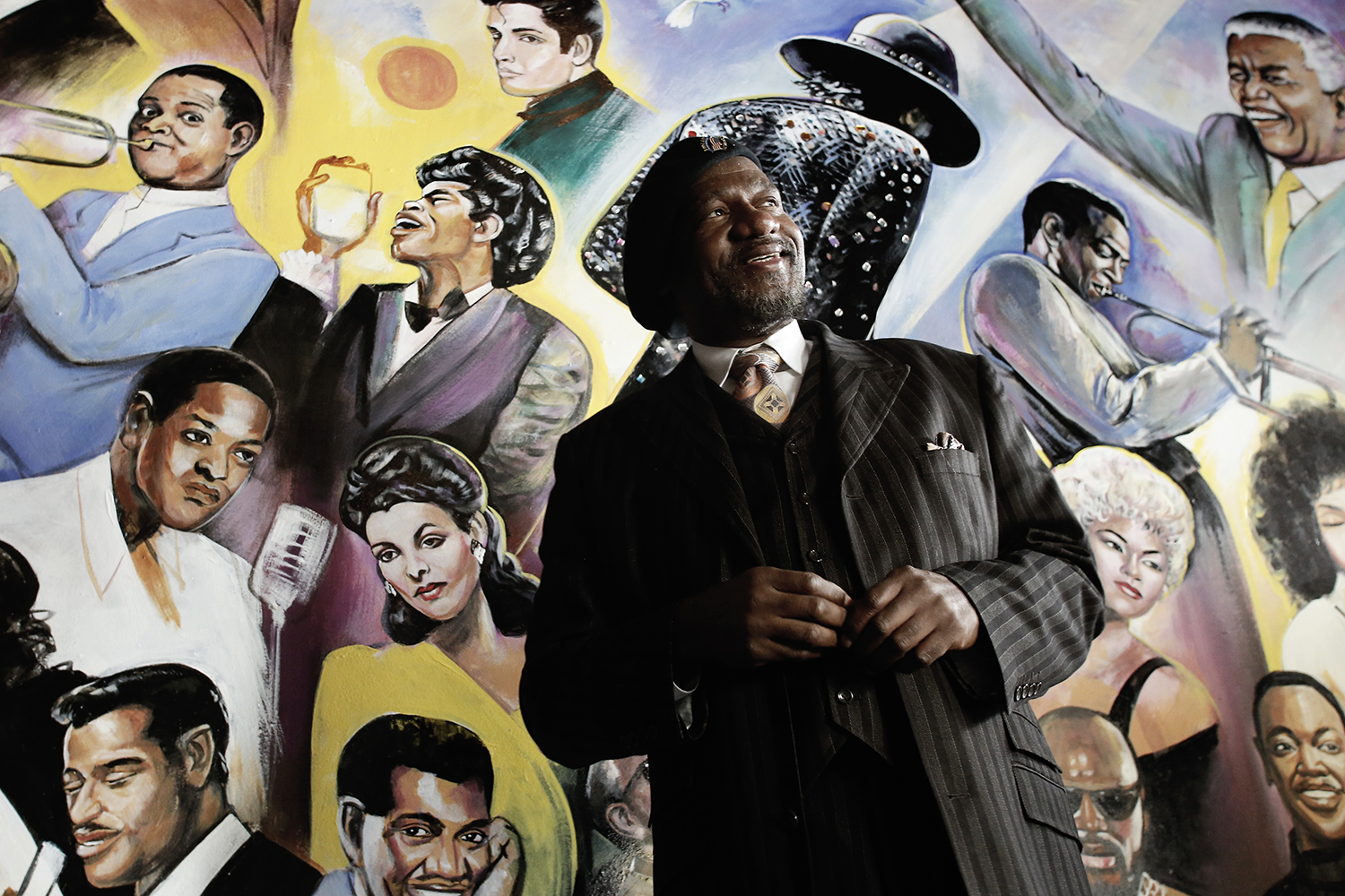 Curtis Lewis II of Farmington Hills answers questions at the unveiling of his mural at Bert's Warehouse Jazz Cafe on Dec. 19, 2013 in Detroit.