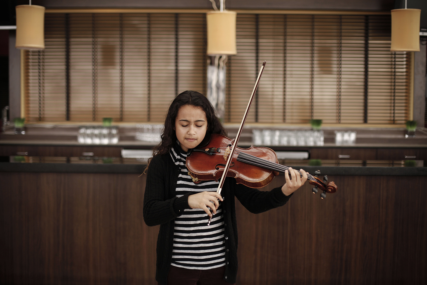 Mya Greene, 17, from Los Angeles, CA plays her viola on Wednesday, Feb. 19, 2014 in the GM Renaissance Center in Detroit. Tim Galloway for Al Jazeera America.