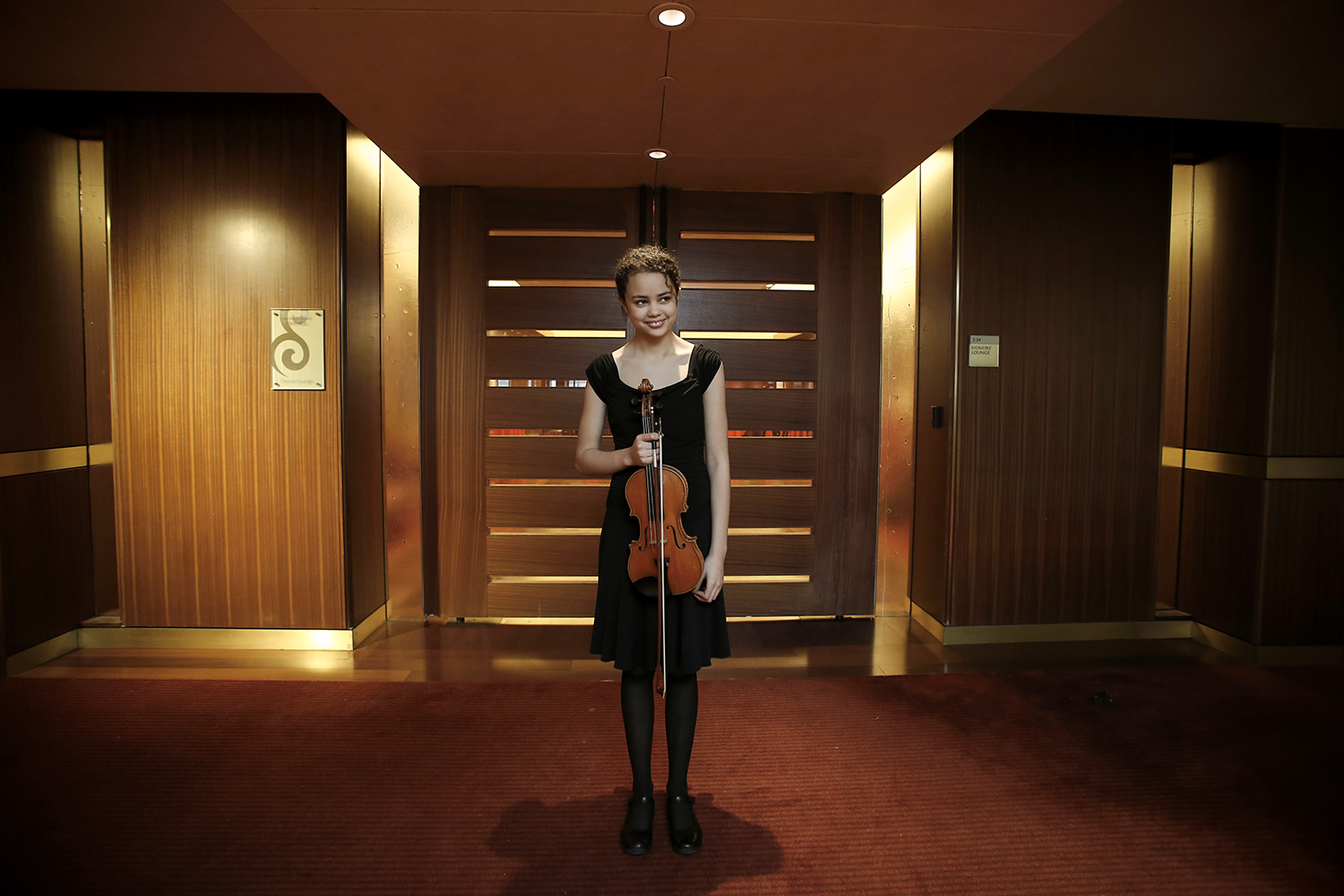 Maria Sanderson,14 (15 on Feb. 28), from Nashville, IN after her individual performance for the Sphinx Competition on Thursday, Feb. 20, 2014 at Orchestra Hall in Detroit. Tim Galloway for Al Jazeera America.