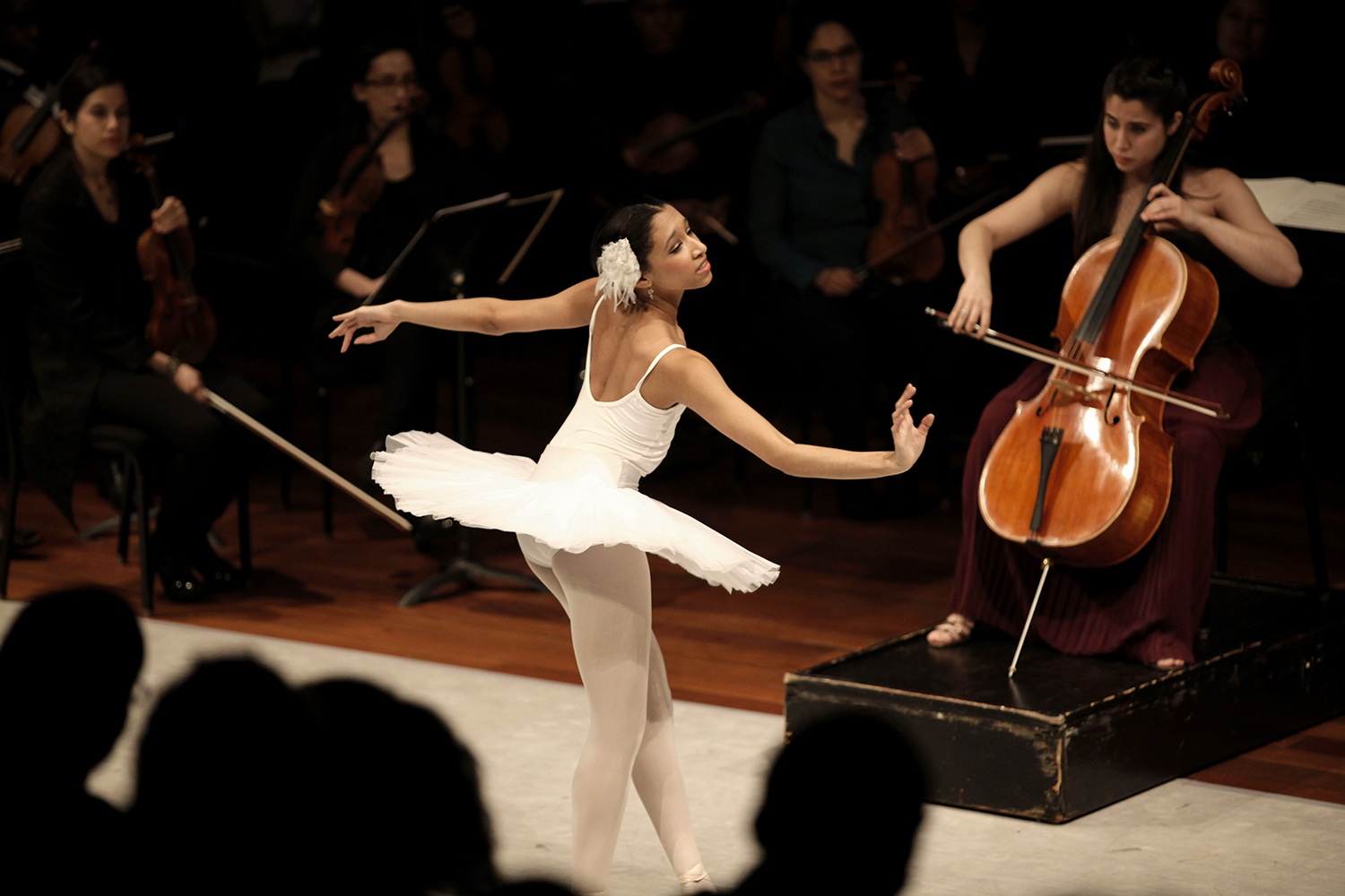 Erica Lall, left, dances while Christine Lamprea plays the cello before the Junior Division Honors Concert on Friday, Feb. 21, 2014 at Orchestra Hall in Detroit. Tim Galloway for Al Jazeera America.