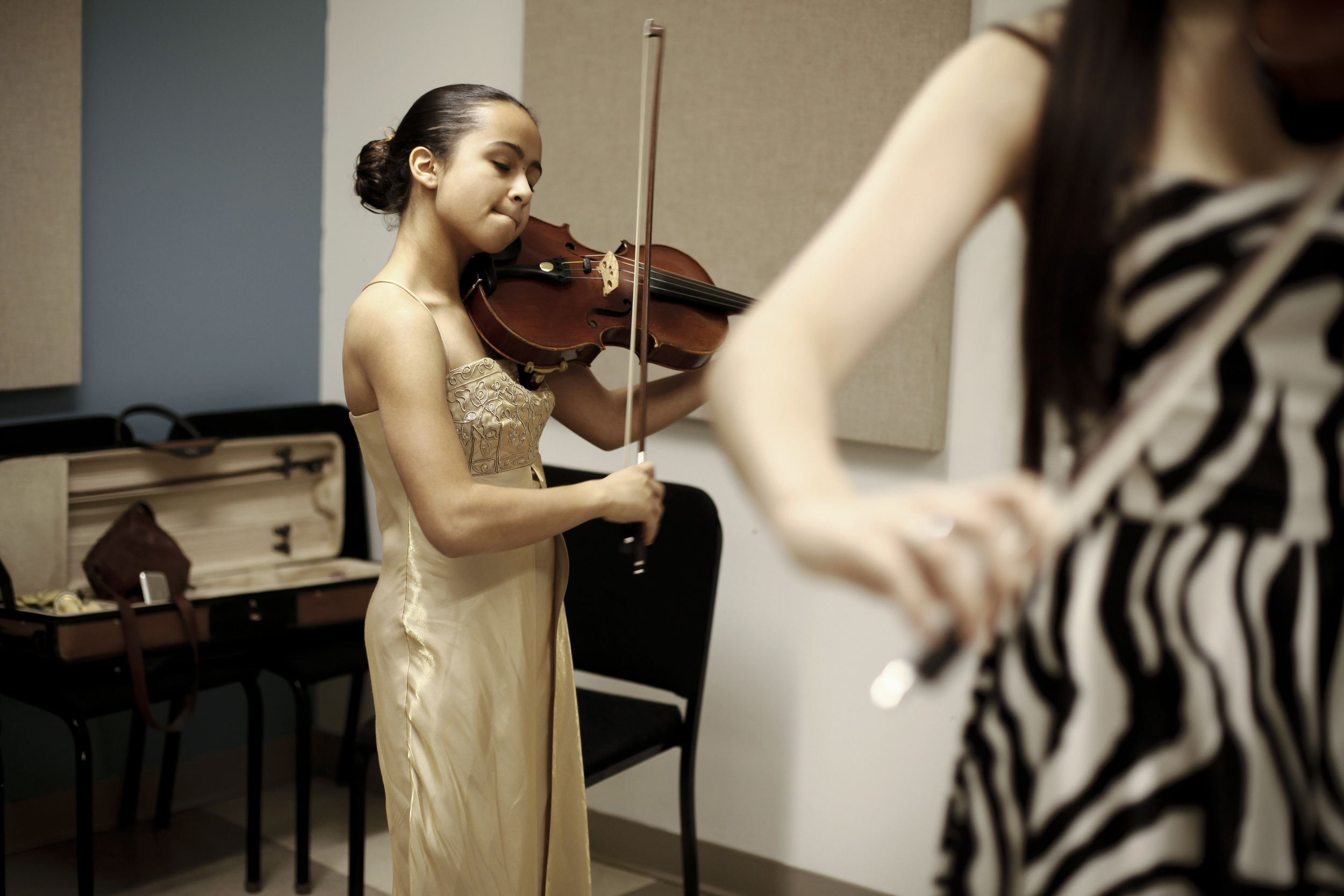 Mya Greene, 17, from Los Angeles, CA practices in the Sphinx Competition women's practice room on Thursday, Feb. 20, 2014 at Orchestra Hall in Detroit. Tim Galloway for Al Jazeera America.