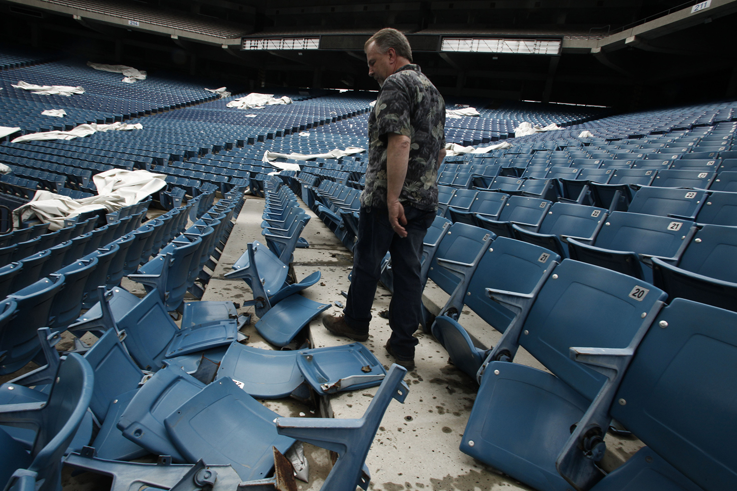 Jim Passeno, 58, from Commerce Twp. carefully steps around a damaged seating section at the Pontiac Silverdome on Friday, May 9, 2014 in Pontiac. Tim Galloway for Al Jazeera America
