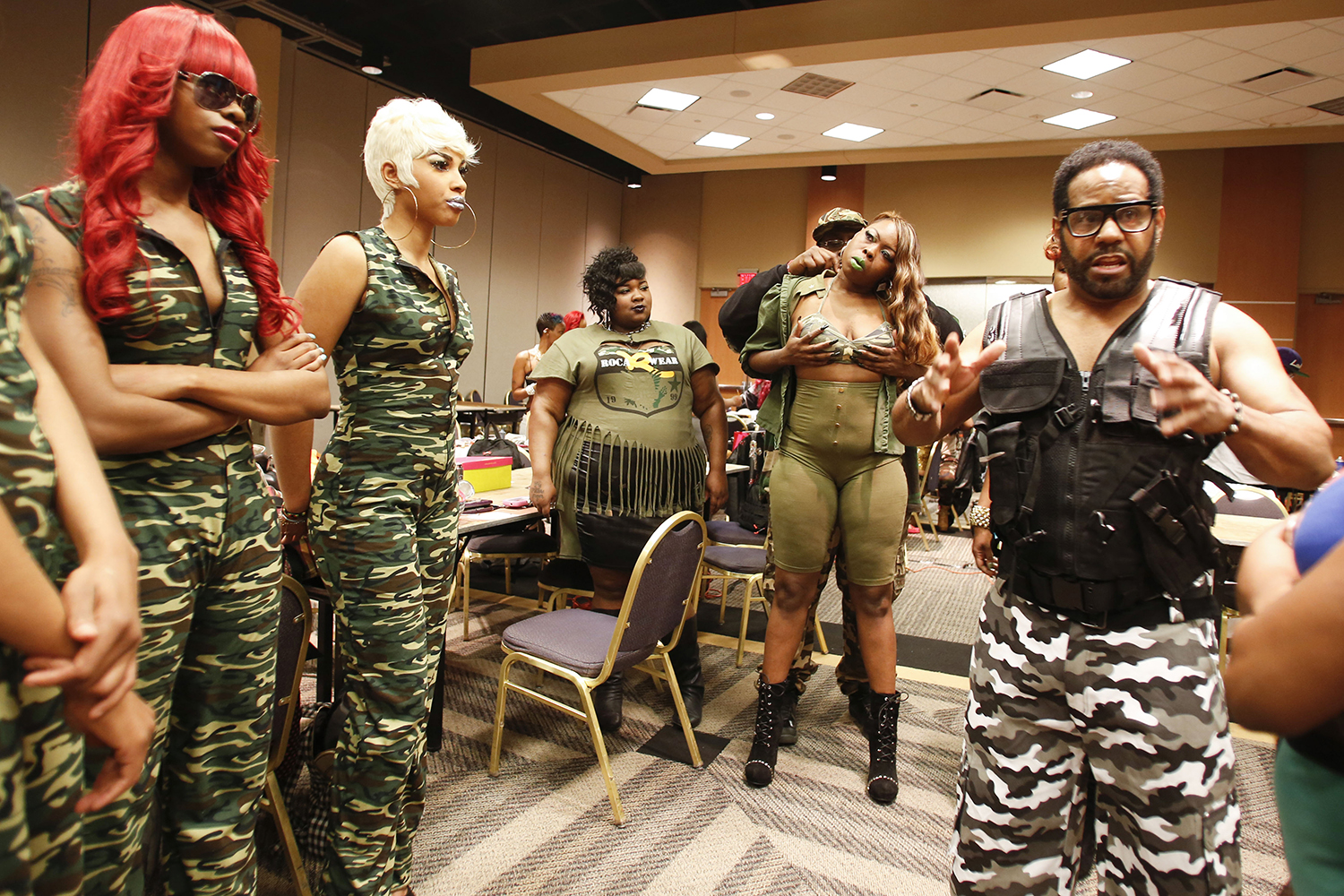 Anthony Stewart, 35, center left, assists Keya Pearson, 35, center right, with her costume before taking the stage for Hair Wars on Sunday, May 4, 2014 at the Adoba Hotel in Dearborn. Tim Galloway for Al Jazeera America