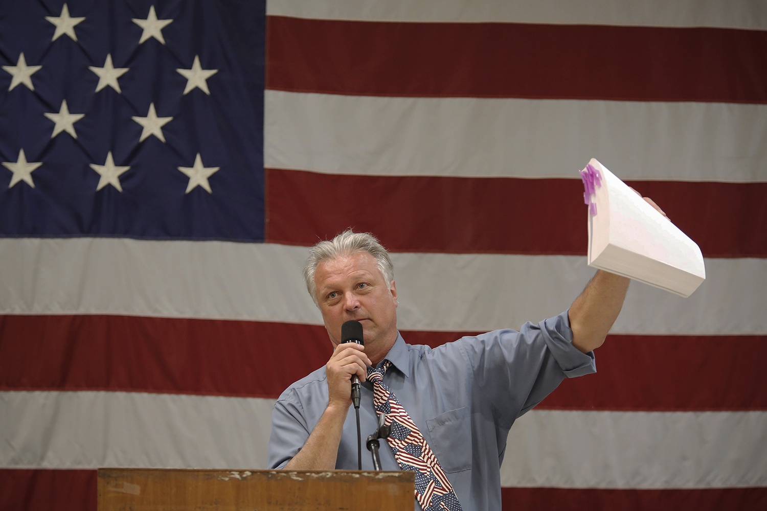 George Orzech, chairman of the Police and Fire Retirement System, holds up a large manual that was emailed out on CD during Detroit Police and Fire Pension Fund Meeting on Wed., June 4, 2014 at the IBEW Local 58 in Detroit. Tim Galloway for The New York Times