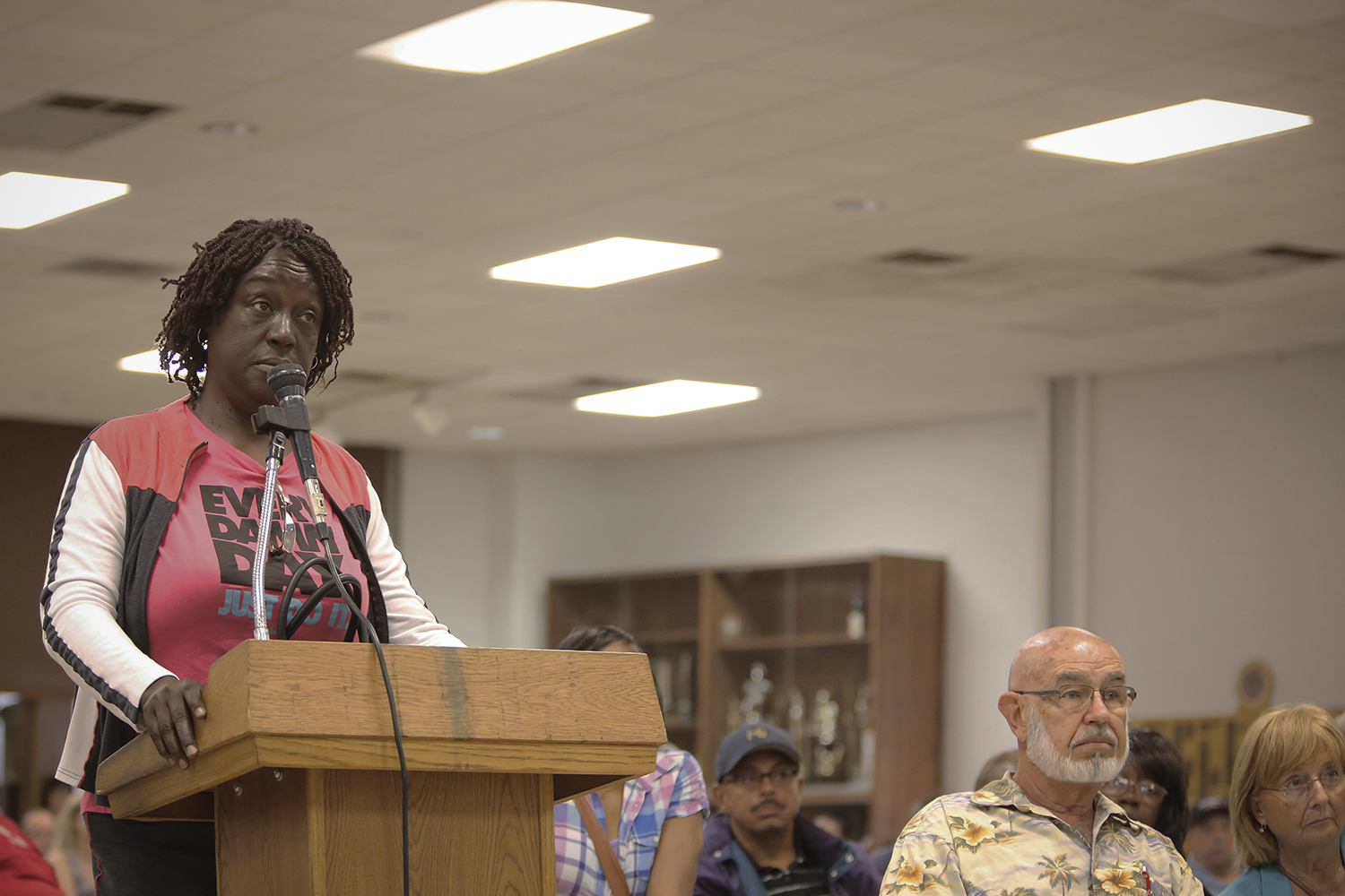 Verdine Day from Detroit, a fire engine operator, asks questions regarding health benefits during the Detroit Police and Fire Pension Fund Meeting on Wed., June 4, 2014 at the IBEW Local 58 in Detroit. Tim Galloway for The New York Times