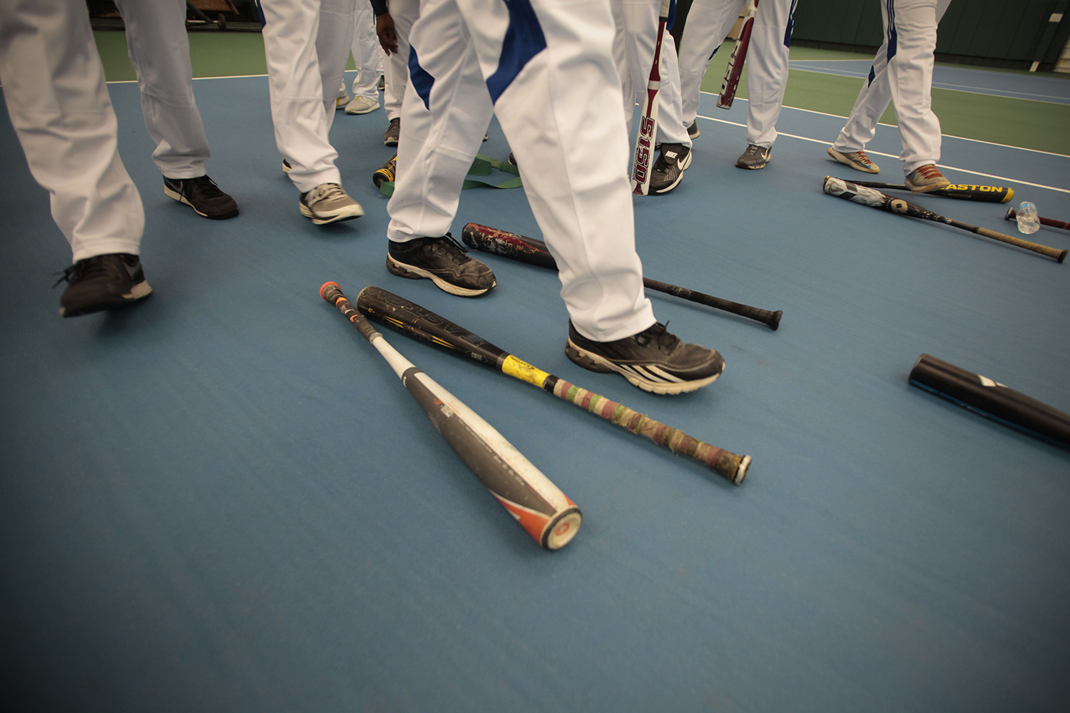 Participants walk over to reclaim their bats before the Muscle Milk Heavy Hitter Home Run Derby on Thur., July 17, 2014 at Wayne State University in Detroit. Tim Galloway/Special for DFP