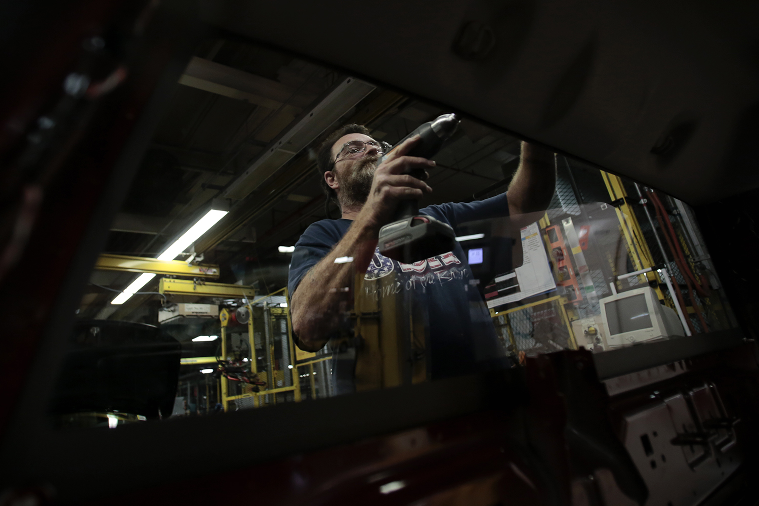 John Jaggers from Davison installs a brake light into the cab of a Ram truck during the media open house on Thursday, Sept. 25, 2014 at the Chrysler Group Warren Truck Assembly plant in Warren. Tim Galloway/Special for DFP