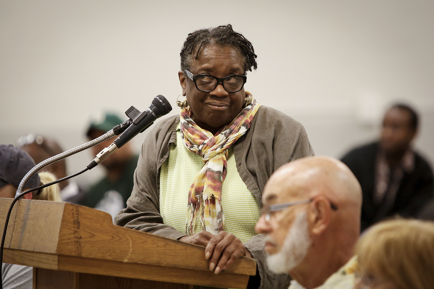 An attendee reacts to the response of her question during the Detroit Police and Fire Pension Fund Meeting on Wed., June 4, 2014 at the IBEW Local 58 in Detroit. Tim Galloway for The New York Times