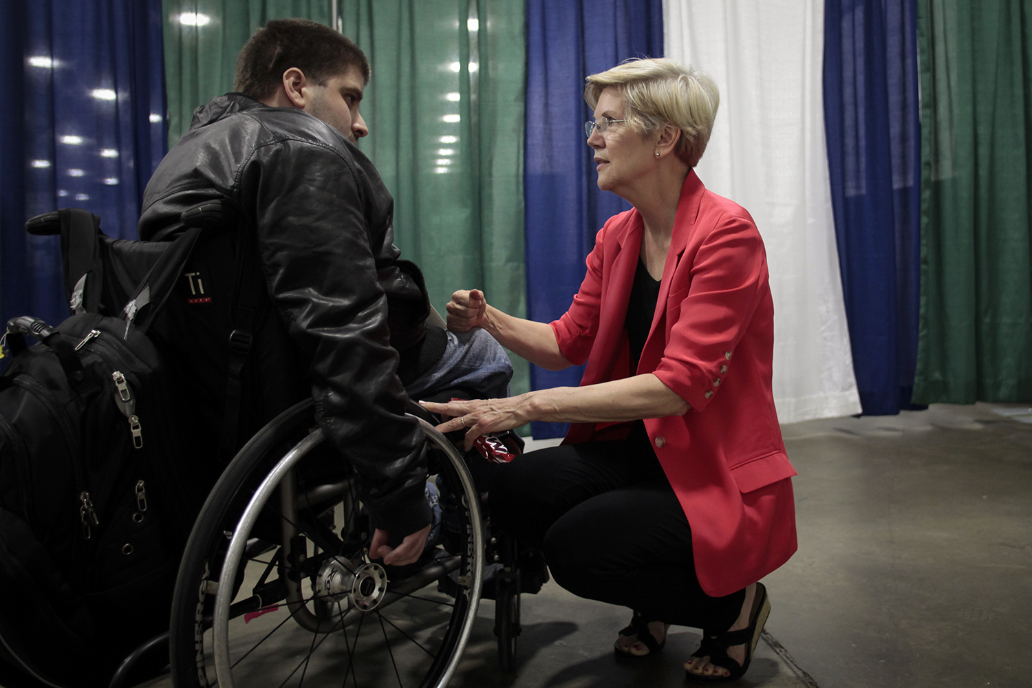 FOR NATIONAL STORY BY SHERYL GAY STOLBERG. Senator Elizabeth Warren speaks with Scottie Thomaston, an LGBT activist from Loxley, AL after Warren's book signing on Friday, July 18, 2014 at the Cobo Center in Detroit, MI. Tim Galloway for the NYT