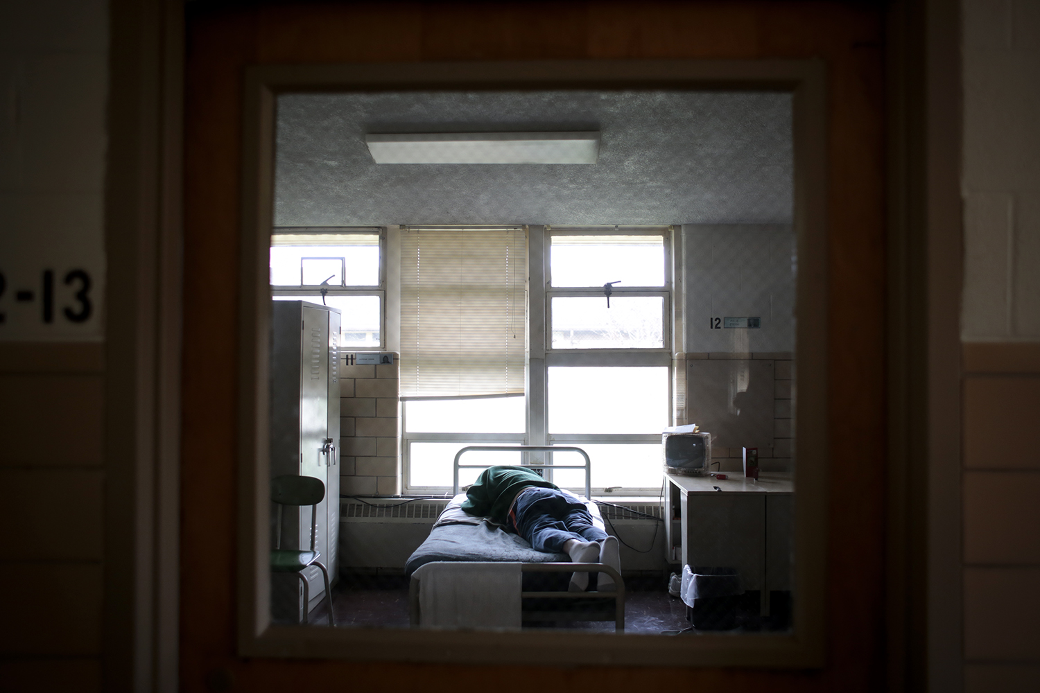 An inmate rests on his bed in his room on Monday, Dec. 1, 2014 at the Lakeland Men's Correctional Facility in Coldwater, MI. Tim Galloway for Al Jazeera America