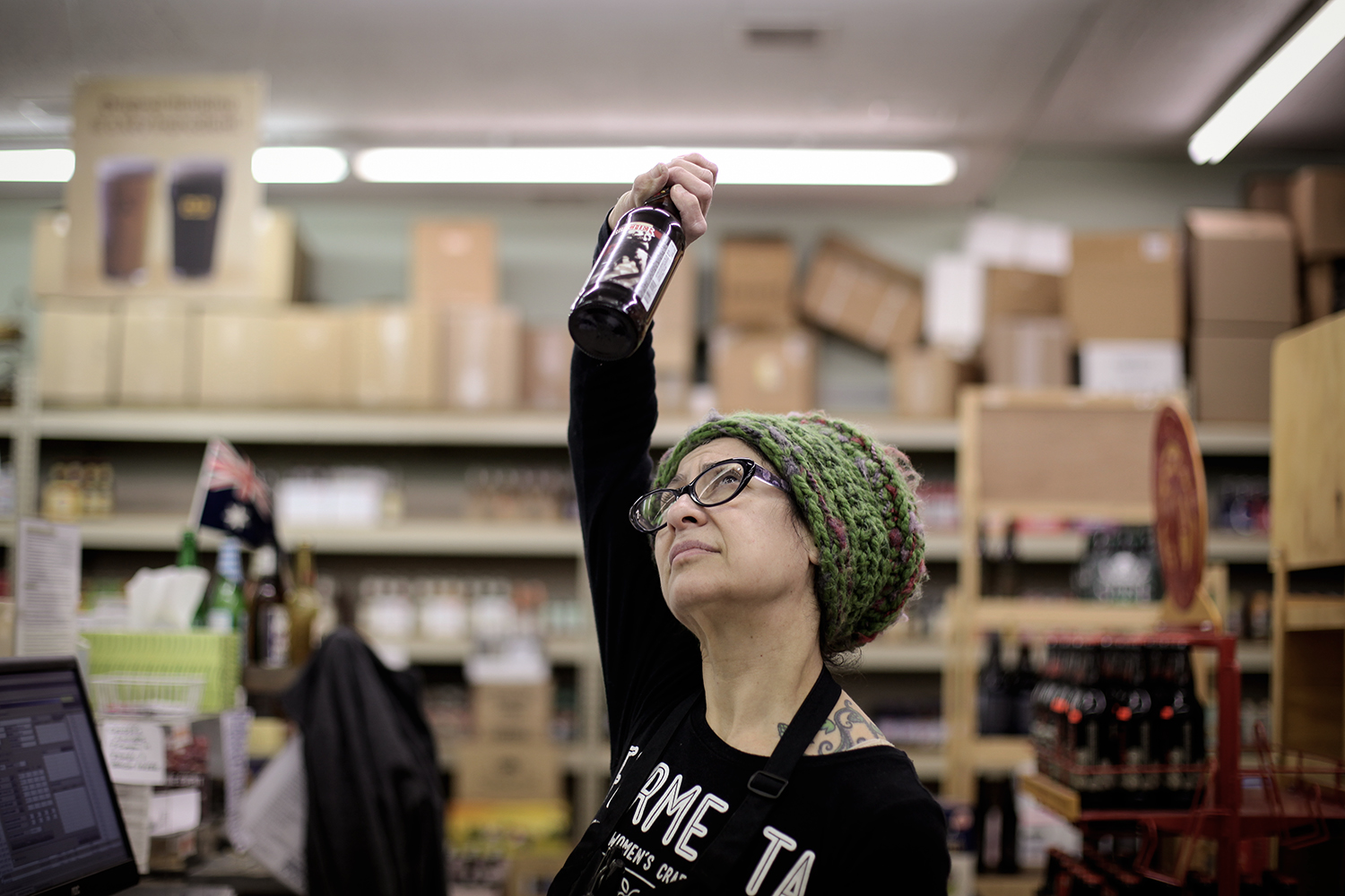Annette May from Allen Park holds a bottle of beer up to the light to determine what type of beer it is at Merchant's Fine Wine on Wednesday, Feb. 4, 2015 in Dearborn. May is the first Cicerone certified woman in the State of Michigan and is involved with Fermenta, a Michigan women's craft collective. Tim Galloway/Special for DFP