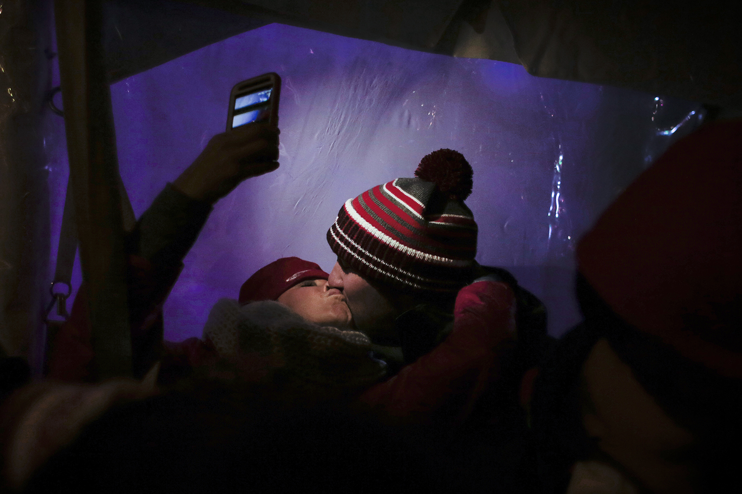 Kelly Davidoff from Nelson, British Columbia, Canada takes a photo of herself kissing Adam Polnik from Chicago after the stroke of midnight on New Year's Eve on Wednesday, Dec. 31, 2014 in Cadillac Square in Detroit. Tim Galloway/Special to DFP