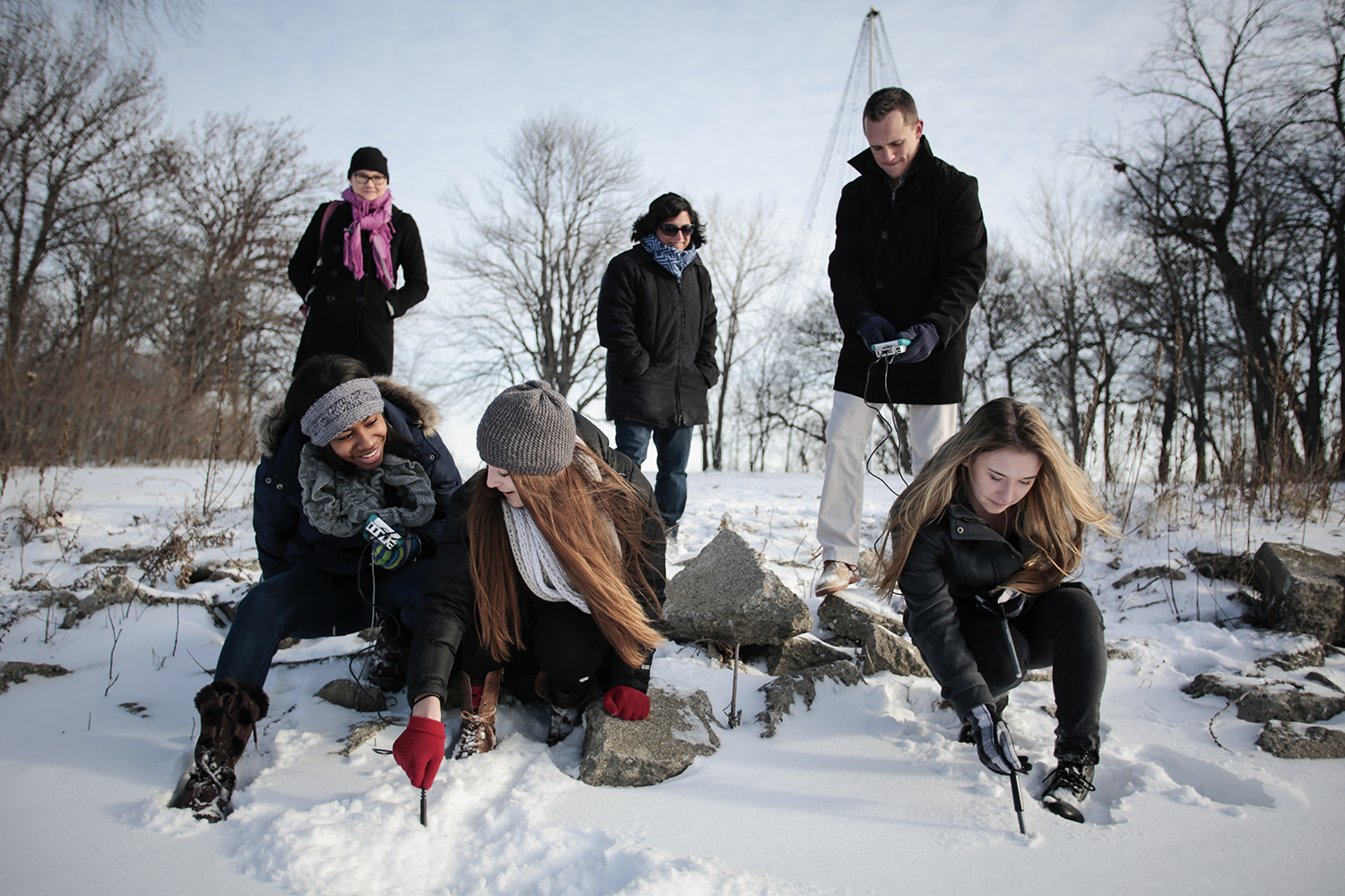 Janet Gocay, top left, from Pleasant Ridge, and Shernaz Minwalla, top center, from Macomb Township, watch as students Kayla Strong, bottom left, from Detroit, Renata Szymanski, bottom center, from Grosse Pointe Woods, Jake Smith, top right, from Warren and Jacqueline Kopicki, bottom right, from Grosse Pointe Woods gather data using electronic probes in Ford's Cove at the Edsel and Eleanor Ford House on Friday, Jan. 9, 2015 in Grosse Pointe Shores. Tim Galloway/Special to DFP