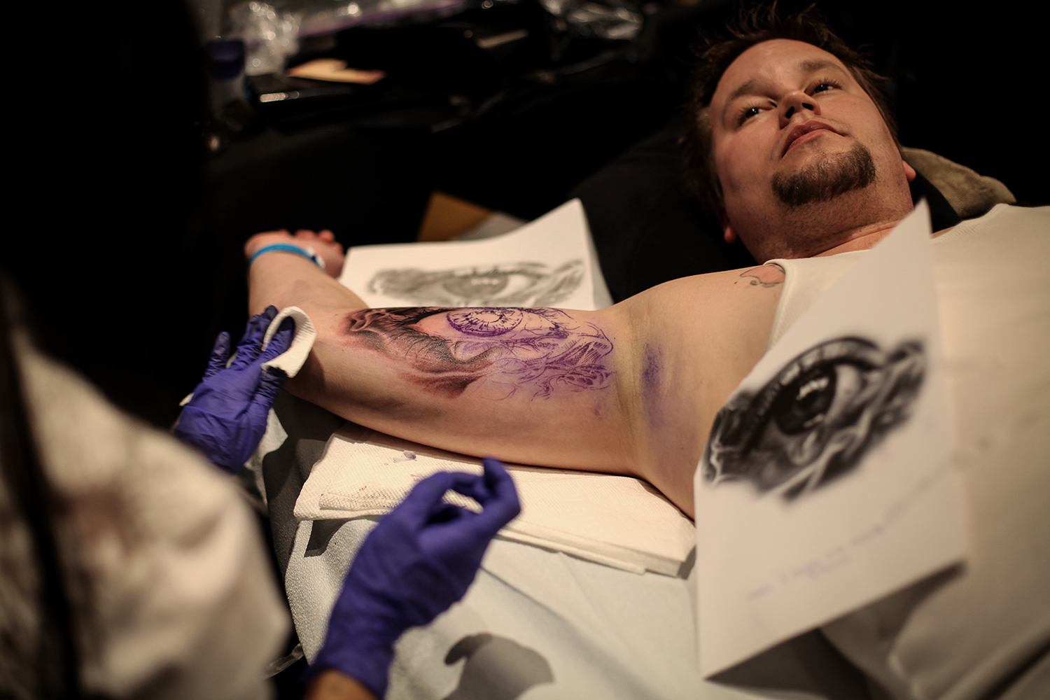 Adam Qureshi, left, from Montreal, Canada tattoos an eye on Ryan Chalmers from Toronto, Canada during the Motor City Tattoo Expo on Saturday, March 7, 2015 at the GM Renaissance Center in Detroit. Tim Galloway/Special to DFP