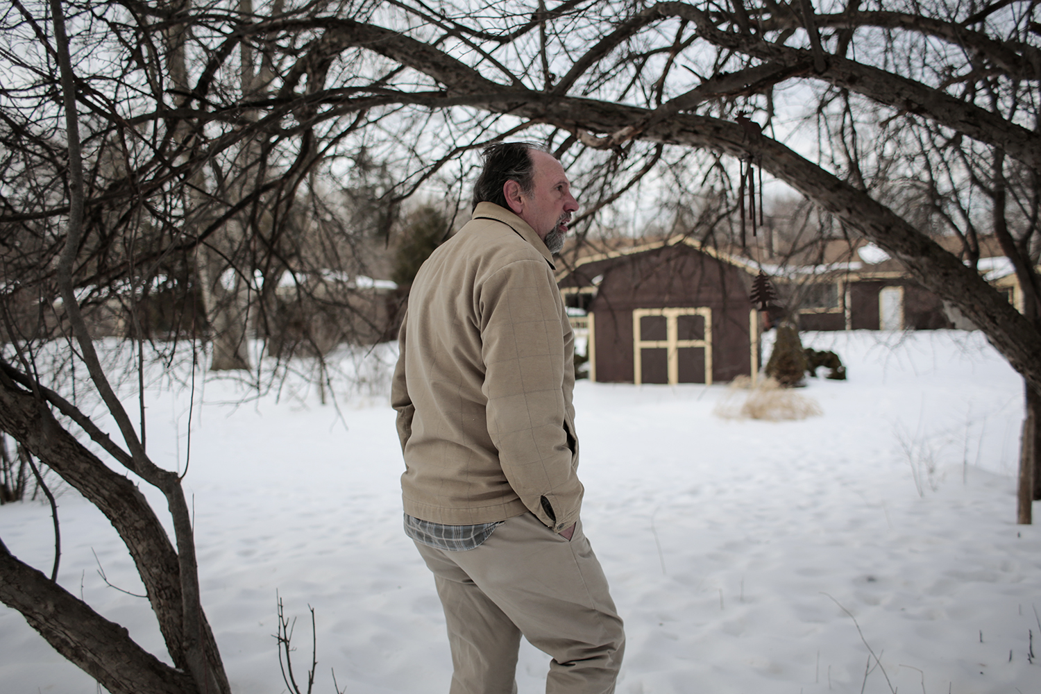 Rick Shriner looks at the deer tracks crossing his yard on Wednesday, March 4, 2015 in Livonia. Deer have become a problem for the Shriners over the past four years, destroying their nicely landscaped yard by destroying fences, shrubbery and trees. Tim Galloway/Special to DFP
