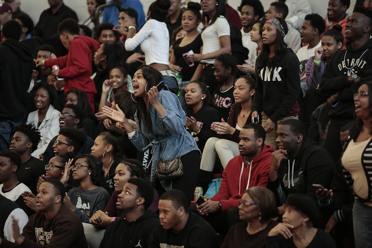 Fans cheer during the Detroit Renaissance vs, U of D Jesuit district semi-final boys' basketball game on Wednesday, March 11, 2015 at Detroit Renaissance High School in Detroit. U of D Jesuit beat Detroit Renaissance 66 to 53. Tim Galloway/Special for DFP