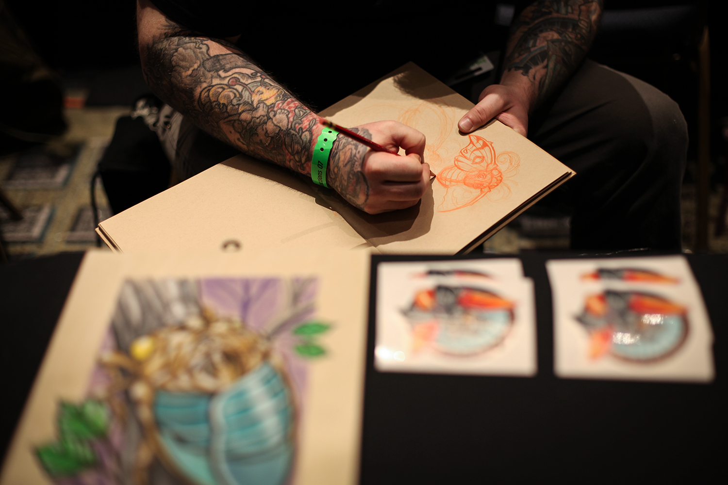 Ben Reese from Memphis, TN draws a moth as he waits for clients during the Motor City Tattoo Expo on Saturday, March 7, 2015 at the GM Renaissance Center in Detroit. Tim Galloway/Special to DFP