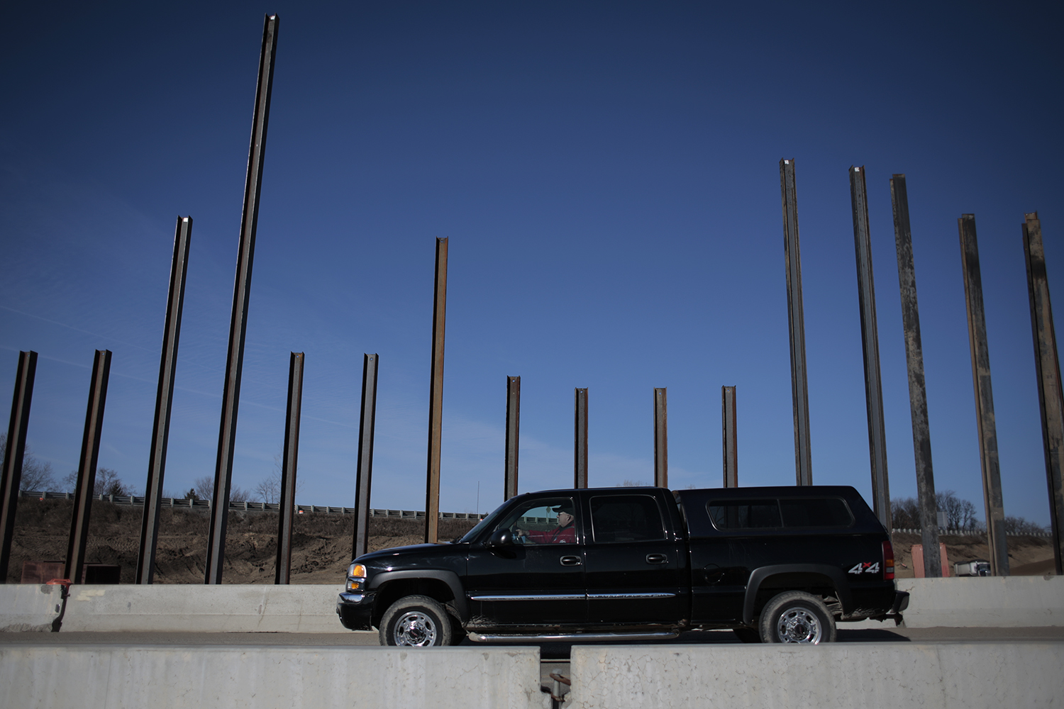 A motorist passes by the supports for the new bridge on Old US-23 on Wednesday, March 18, 2015 at the I-96 and US-23 Interchange in Brighton. Tim Galloway/Special for DFP