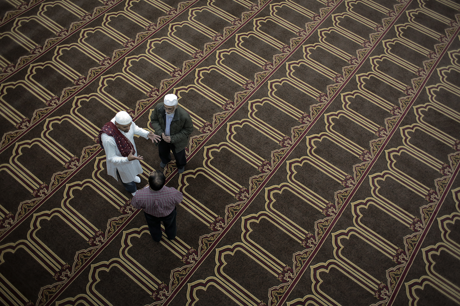 Jameel Syed, left, from Auburn Hills speaks with Noorulla Mohammed, bottom, and Mohammad Zahooruddin, top, both from Farmington Hills before the call to prayer on Thursday, Apr. 2, 2014 at the Tawheed Center in Farmington Hills. Syed plans to travel the United States to do the Muslim call to prayer in each of the 50 states over the next month. Tim Galloway/Special to DFP