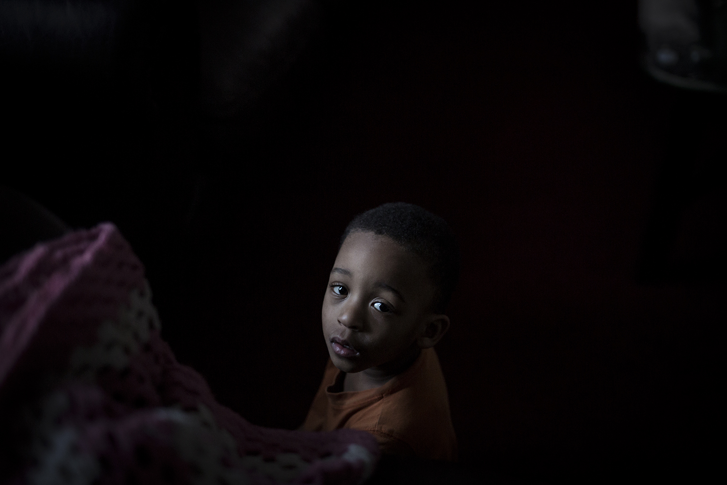 Flint, MI - Feb. 11, 2016:  Ja'Son Keith, 2, sits on the floor in front of a small space heater to keep warm in the living room on Thursday, Feb. 11, 2016 in Flint, MI. 