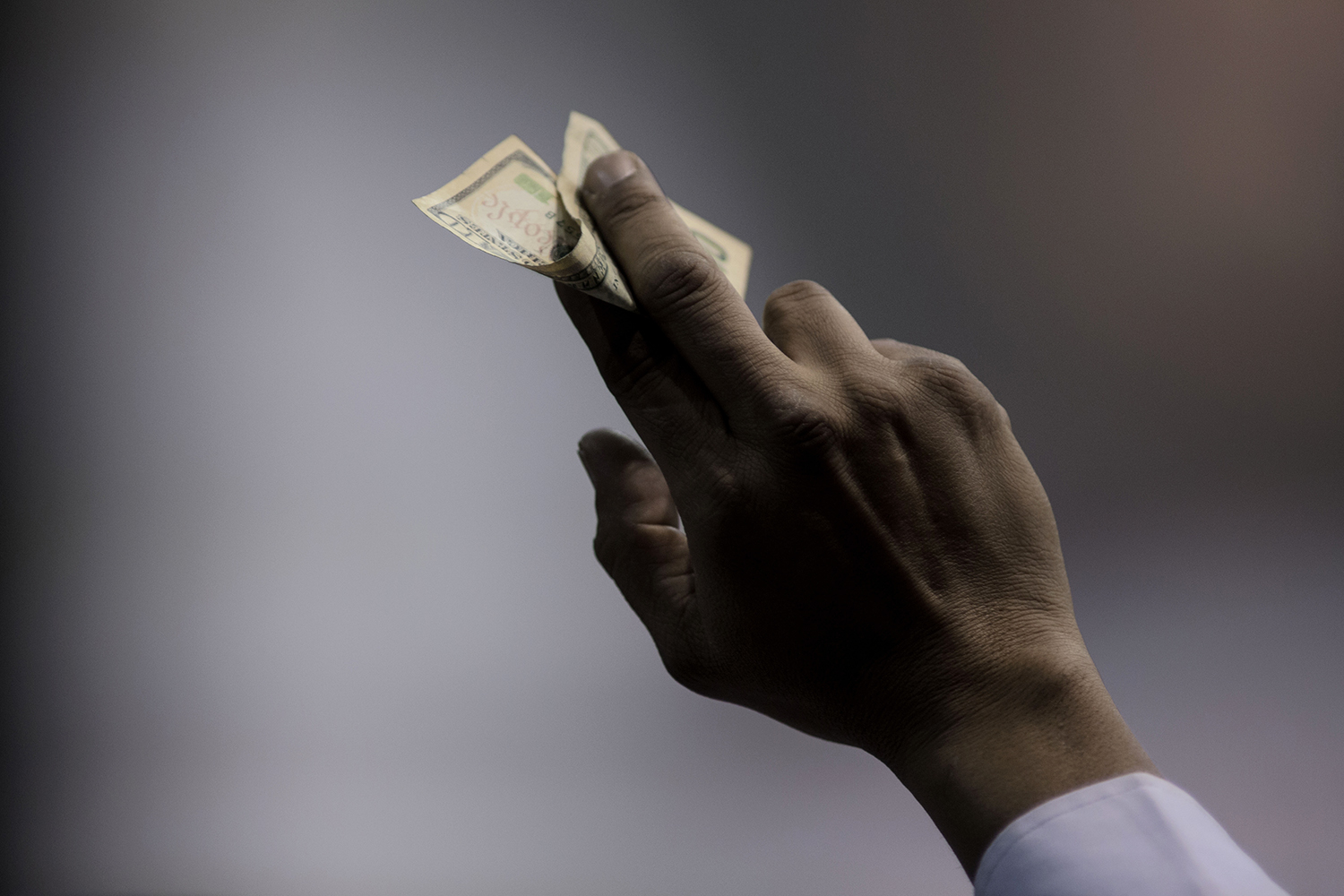 An audience member holds money in the air to be collected for donation during the Nation of Islam Saviour's Day Convention on Sunday, Feb. 21, 2016 at Joe Louis Arena in Detroit. Tim Galloway/Special for DFP