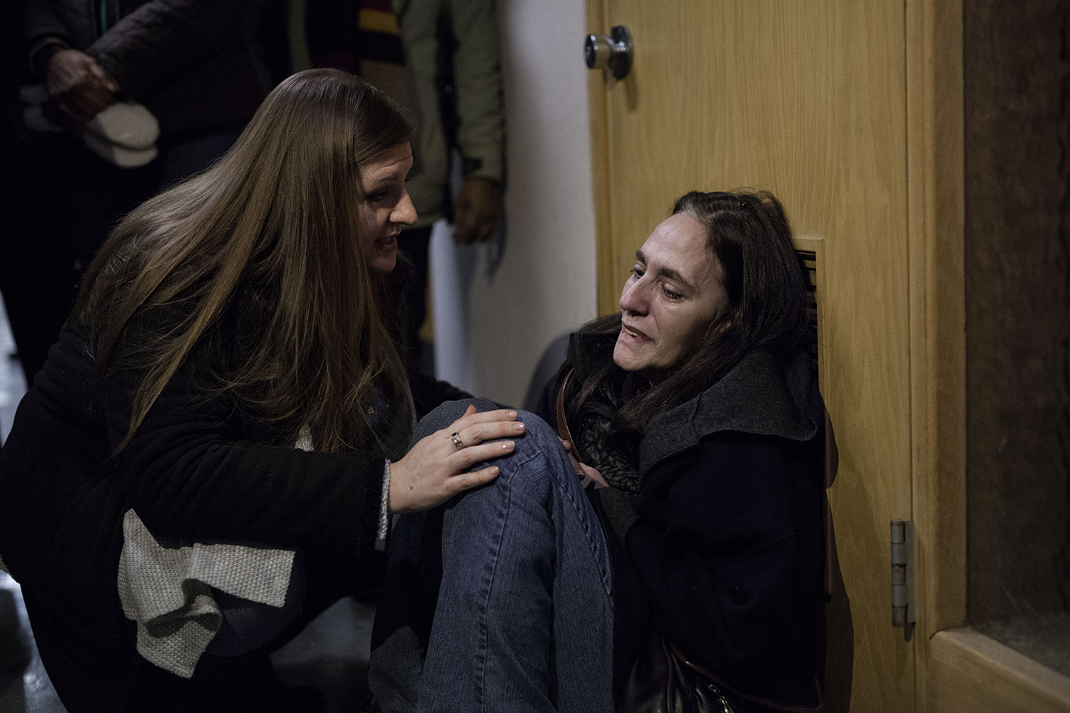 Melissa Mays, left, comforts Andrea Watson, right, both from flint, while they wait outside of the conference room the Flint water criss press conference on Monday, Jan. 11, 2016 at City Hall in Flint. Flint residents gathered at City Hall to voice their disdain with the water crisis. Tim Galloway for The Detroit Free Press