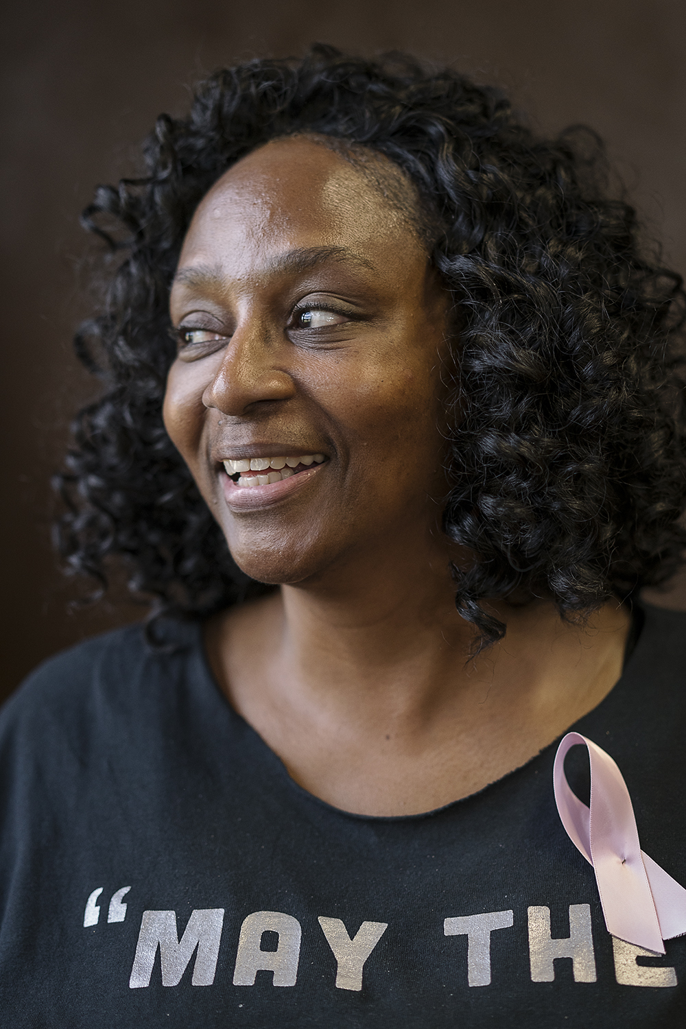 Flint, MI - Monday, October 16, 2017:  Wearing a pink ribbon to display support for National Breast Cancer Awareness Month, Sheila Miller-Graham from Flint, has her portrait taken on the dance floor in the Berston Field House. In September, 1982 Miller-Graham established the Creative Expressions Dance Studio, based in Berston, providing the local youth a place to learn the discipline of dance.
