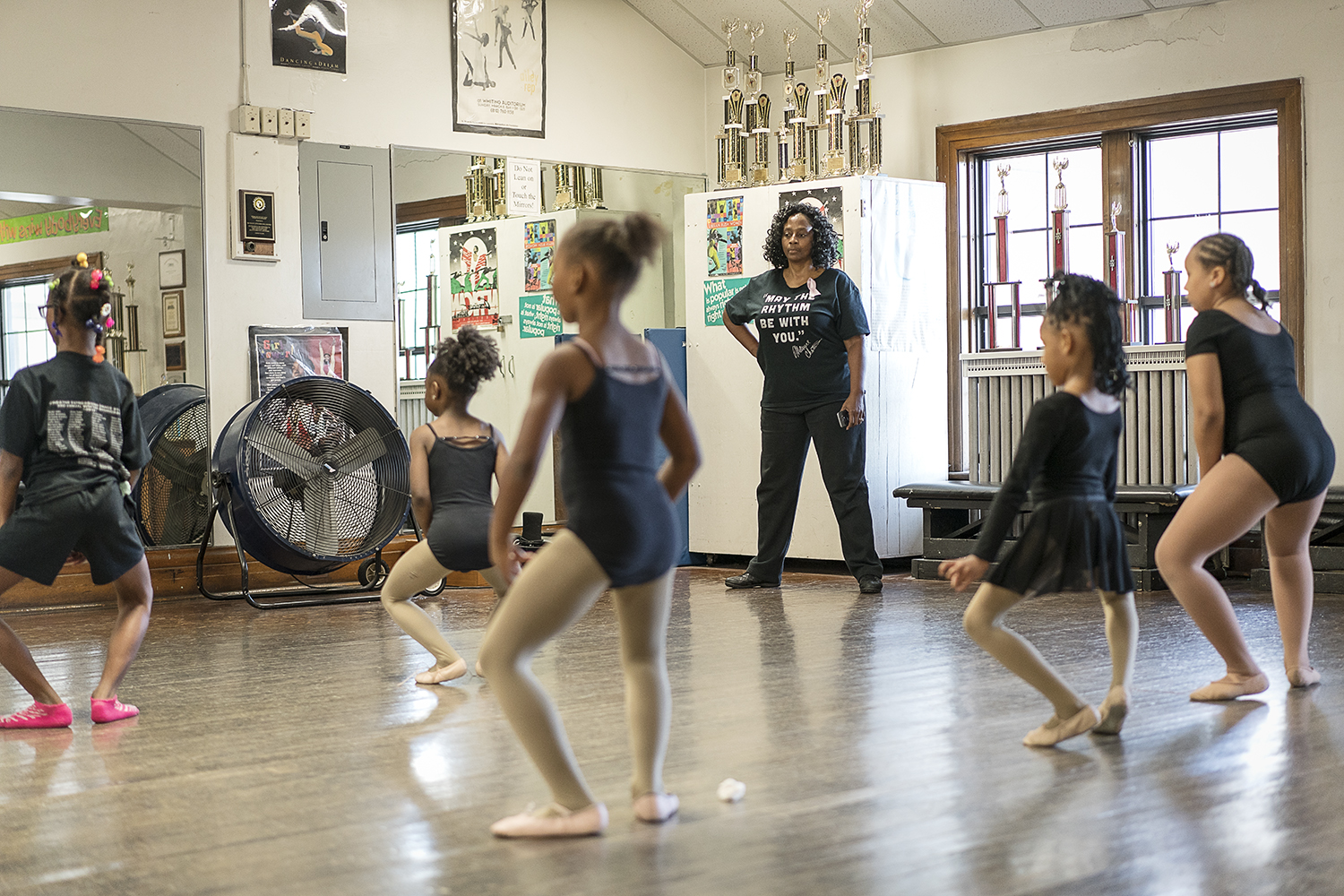 Flint, MI - Monday, October 16, 2017: In a small second-floor studio in the Berston Field House in Flint, Sheila Miller-Graham, center, from Flint, watches a young ballet class practice in front of the mirror. Miller-Graham, along with the other instructors at the Creative Expressions Dance Studio, work to instill a sense of confidence in the dancers to aid them in succeeding in not only dance, but anything else they decide to pursue.