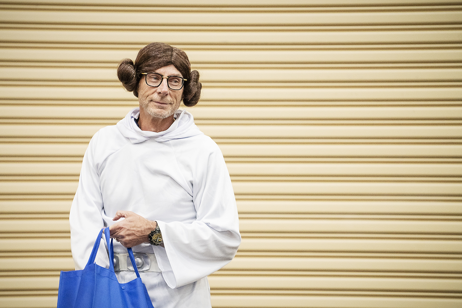 Flint, MI - Friday, May 4, 2018: Fenton Twp. Resident and Blueberry Founder Phil Shaltz, 69, looks across the crowd of Blueberry Ambassadors while dressed as Princess Leia from Star Wars before handing out blueberry-replica stress balls during the 5th Annual Blueberry Ambassador Awards Party at the Riverfront Banquet Center downtown.