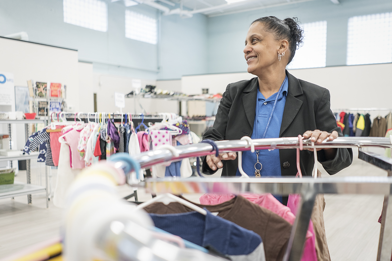 Flint, MI - Monday, December 18, 2017: Redonna Riggs, 47, of Flint, smiles at a volunteer across the room at the Catholic Charities Community Closet at the Center for Hope. 