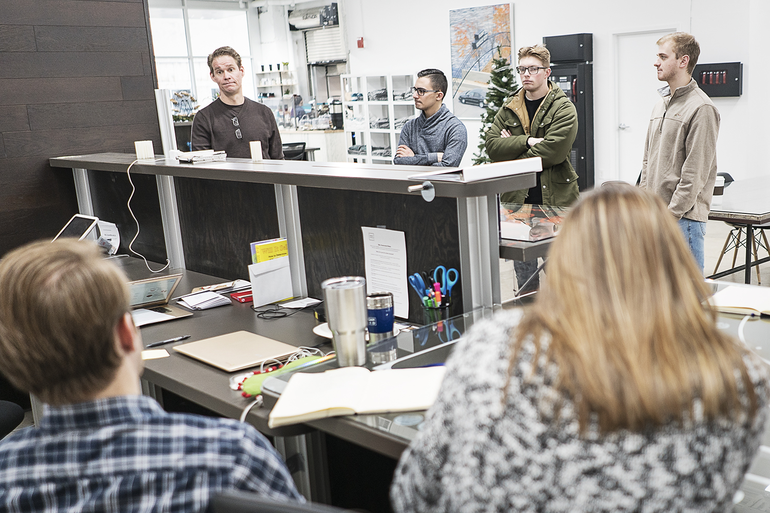Flint, MI - Friday, December 22, 2017: David Ollila, 47, of Linden, (left) President and Chief Innovation Officer for Skypoint Ventures has a meeting with the staff of 100k Ideas to get the day started.Tim Galloway for FlintSide