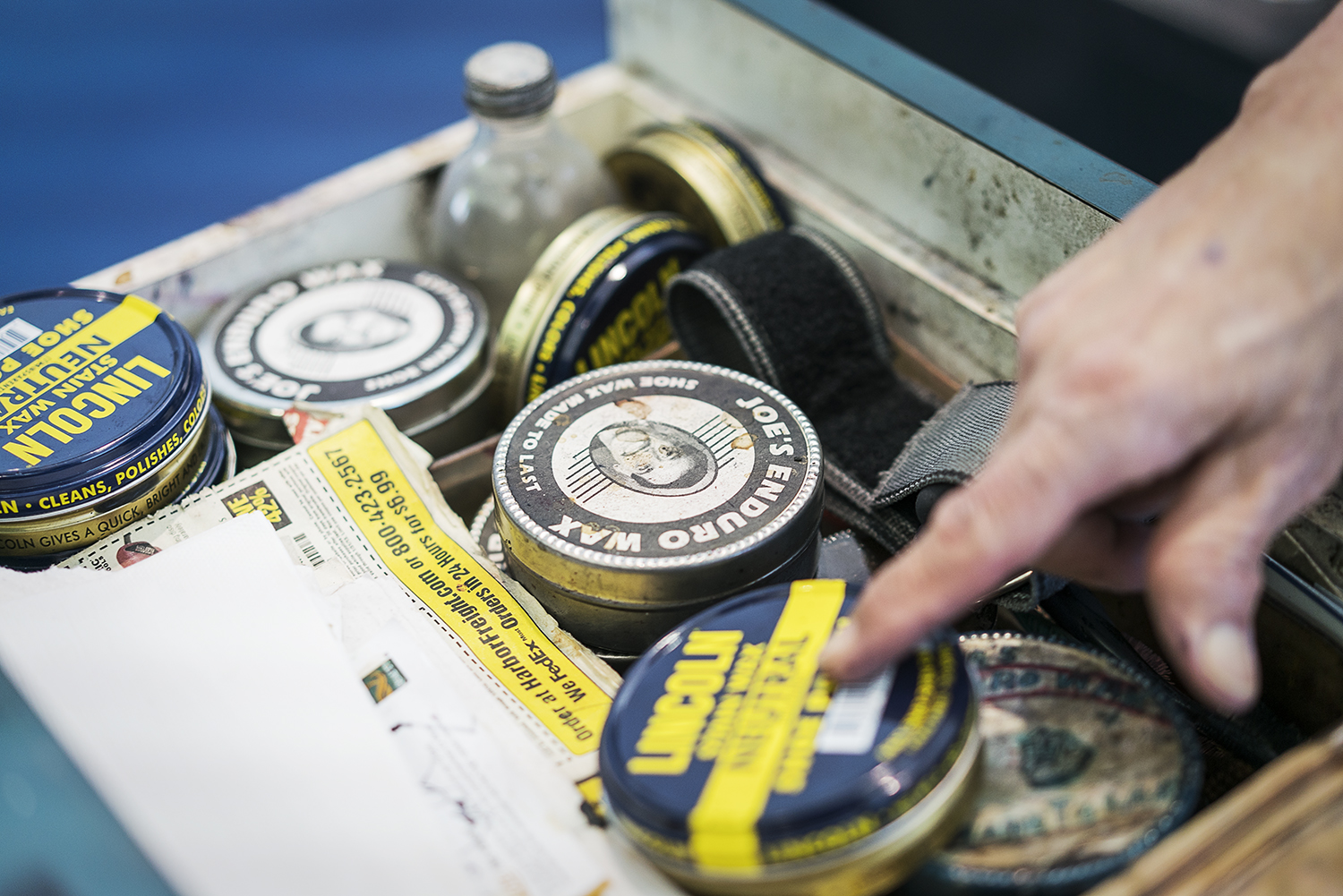 Flint, MI - Friday, January 26, 2018: Mt. Morris resident Joe Garza, 69, goes through his drawer of shoe polish at the shoe shine stand at Bishop International Airport, where he has worked for 36 years. Tim Galloway for FlintSide