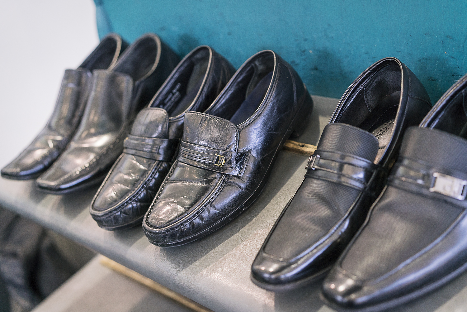 Flint, MI - Friday, January 26, 2018: Customers' shoes wait for attention at the shoe shine stand at Bishop International Airport.Tim Galloway for FlintSide