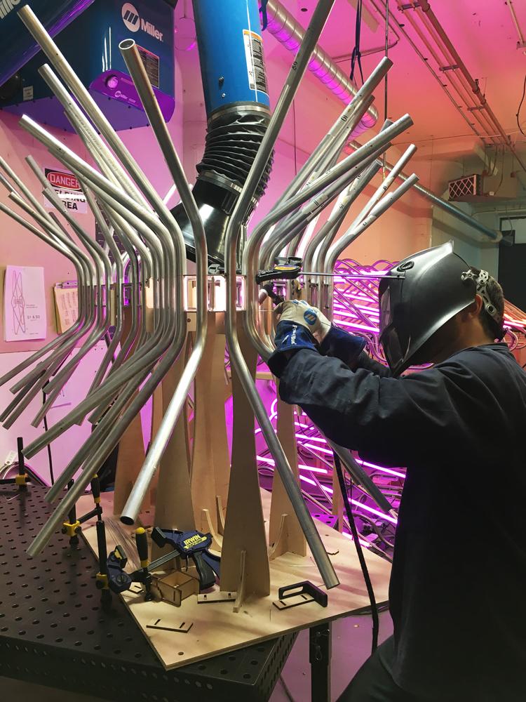 Welding the bent aluminum tubing on the frame
