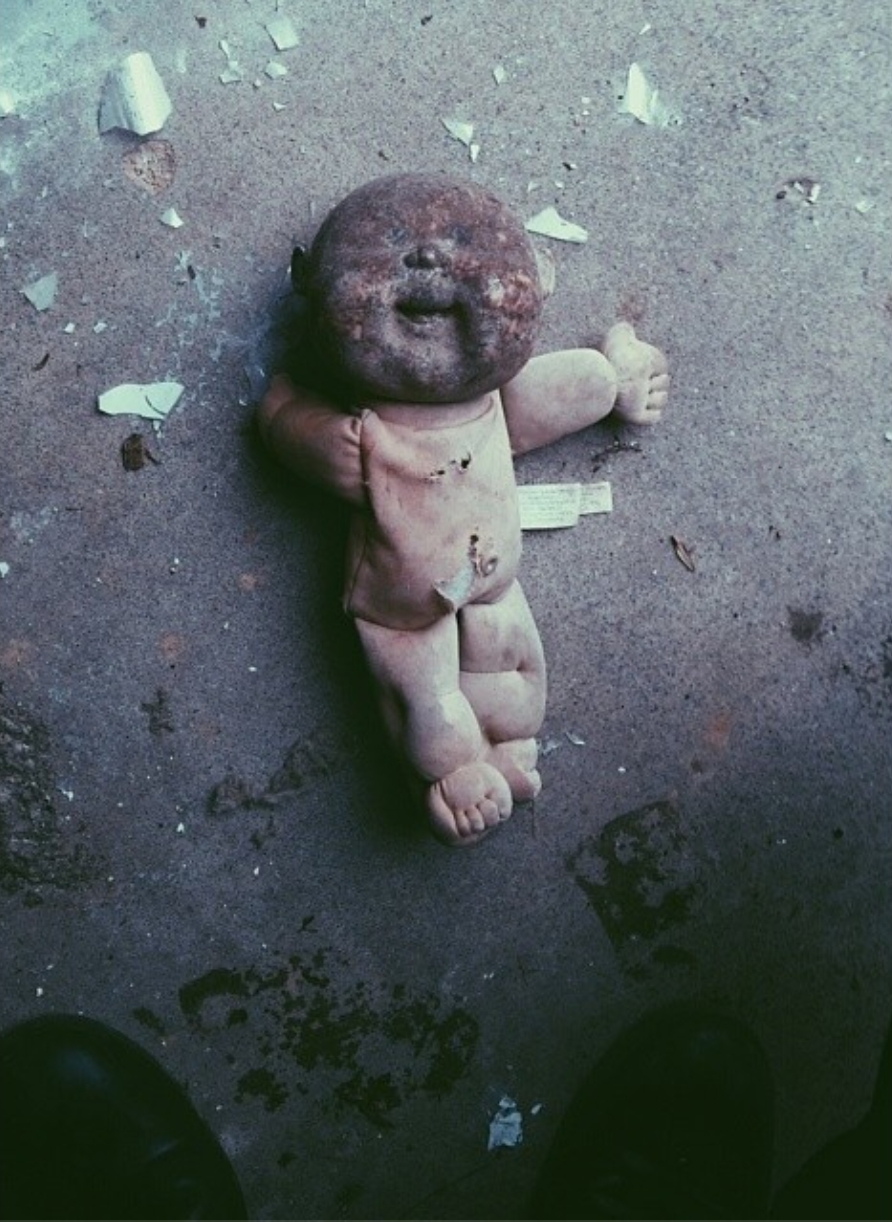 Creepy cabbage patch from hell that we found in the abandoned school  (taken via   Rob's instagram  )