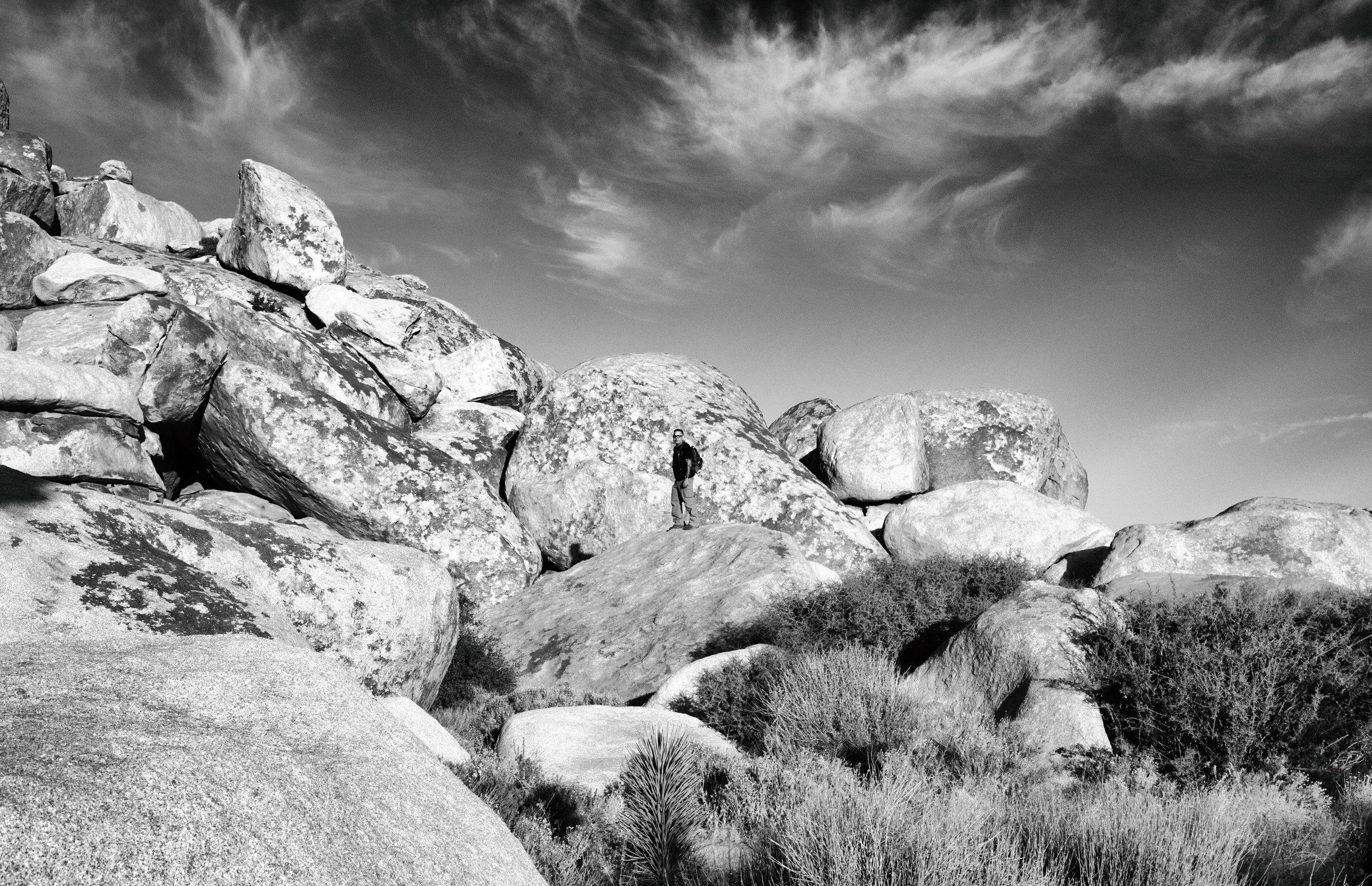 My husband bouldering at Cap Rock.