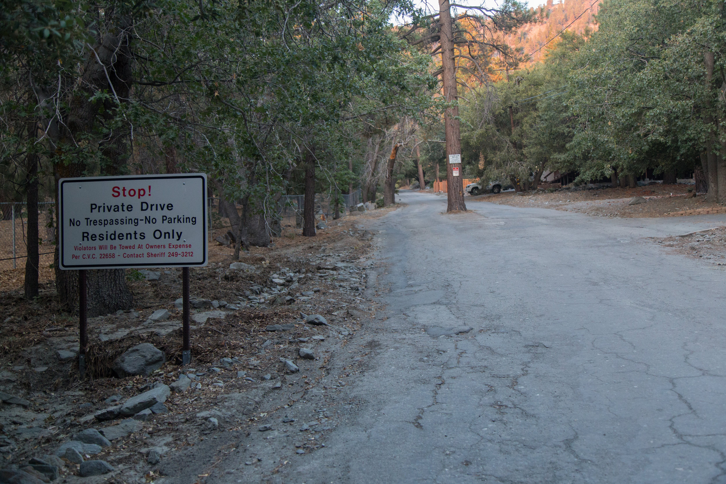Begin the trek by hiking up the steep Acorn Drive for about 3/4 miles.  Do not park past the sign.  This is private property.  There is a turn out just before the sign on the right hand side of the road that fits two cars.  Display your adventure pass and be on your way while being respectful of the residents.