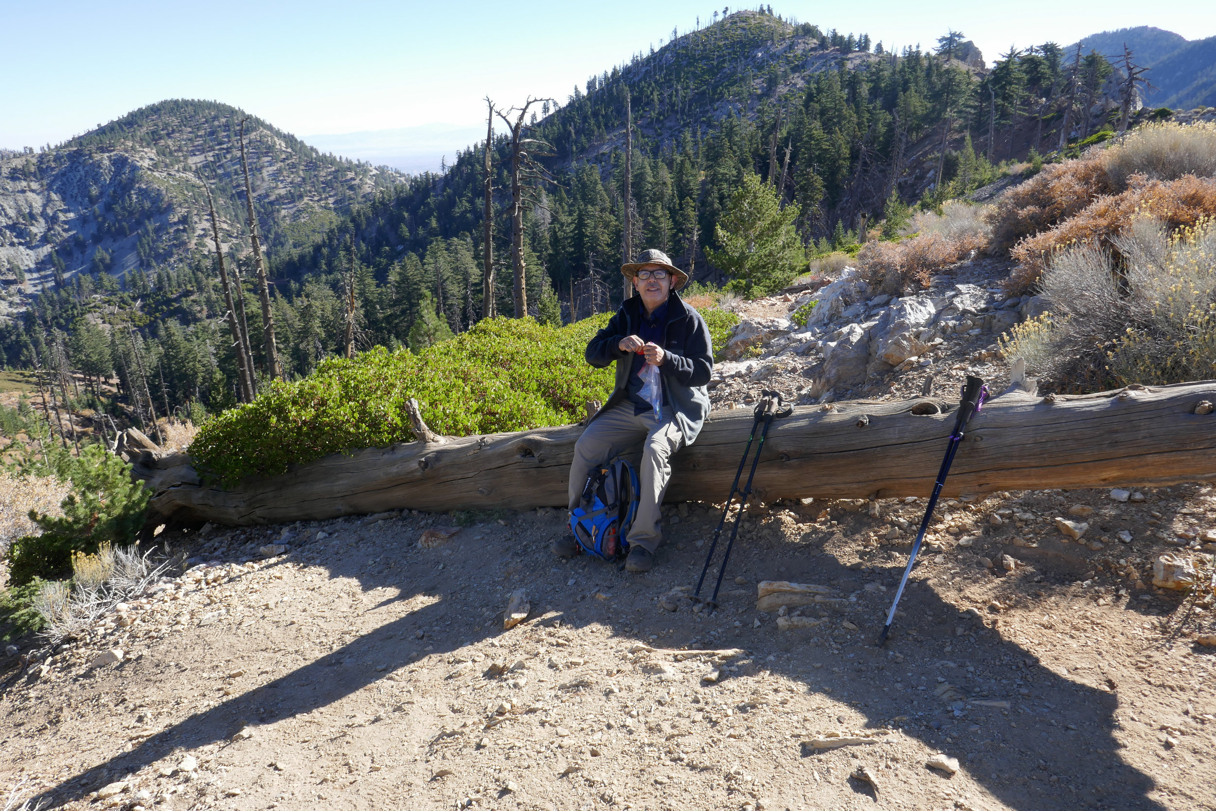 Taking a little break here. Behind my husband from left to right Timber Mountain, Big Horn Peak and Cucamonga Peak.