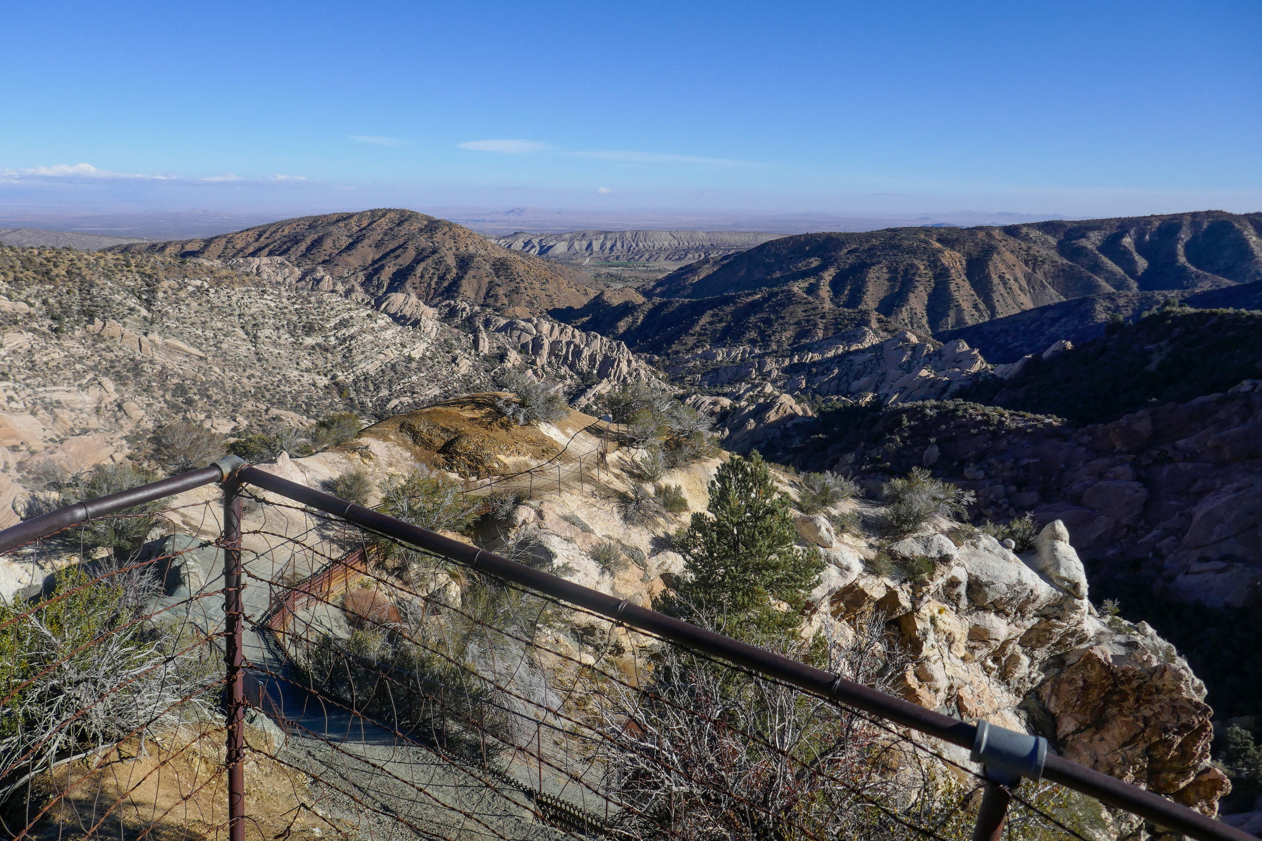The last part of the descent is fenced in so you don't fall off the steep, rocky ledge.