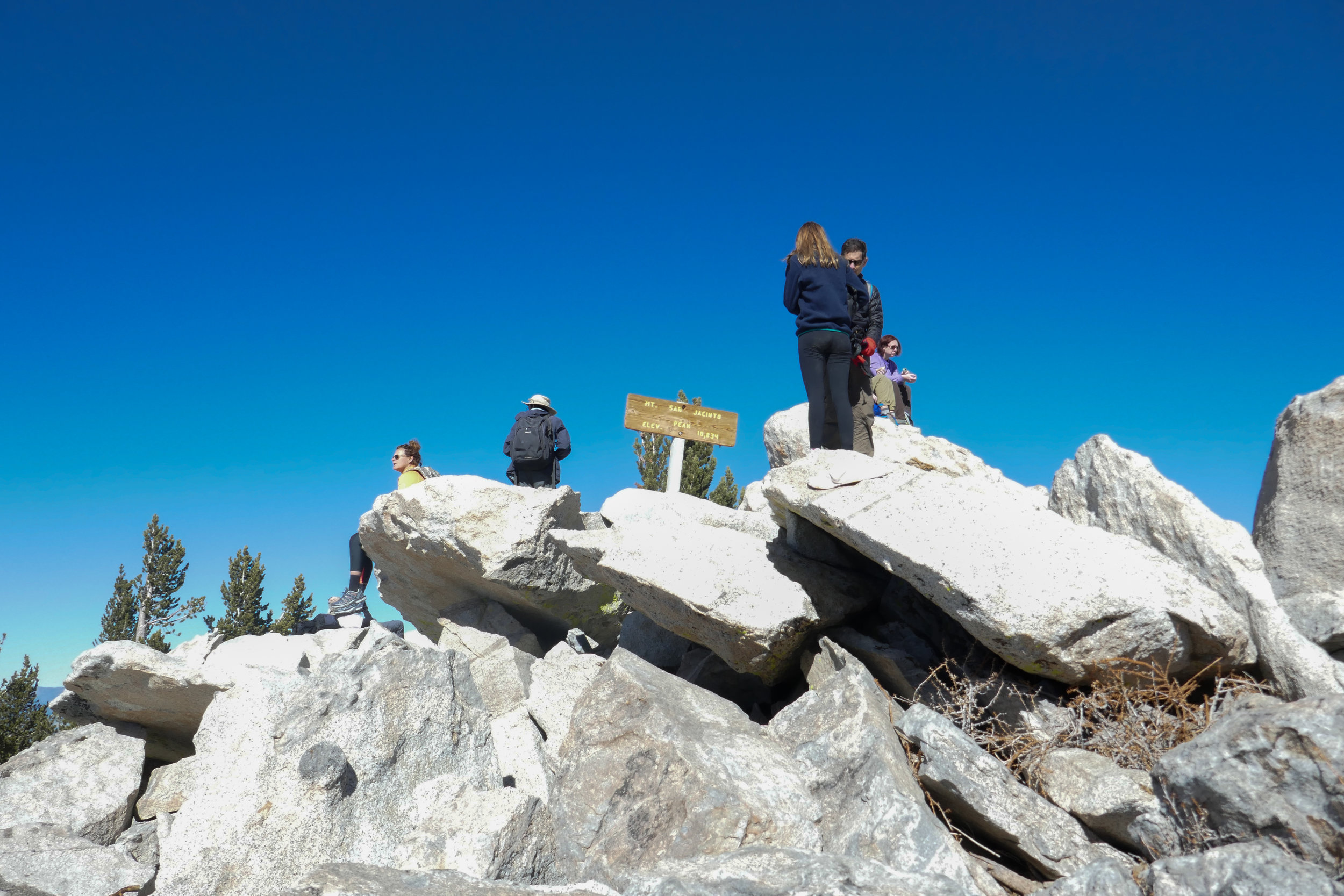 People hanging out at the summit sign getting their pictures. The views from up there were pretty incredible.