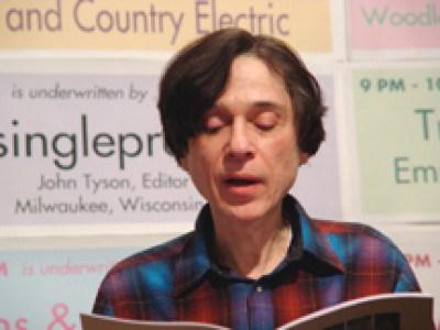 Jeff Poniewaz in mid-reading.