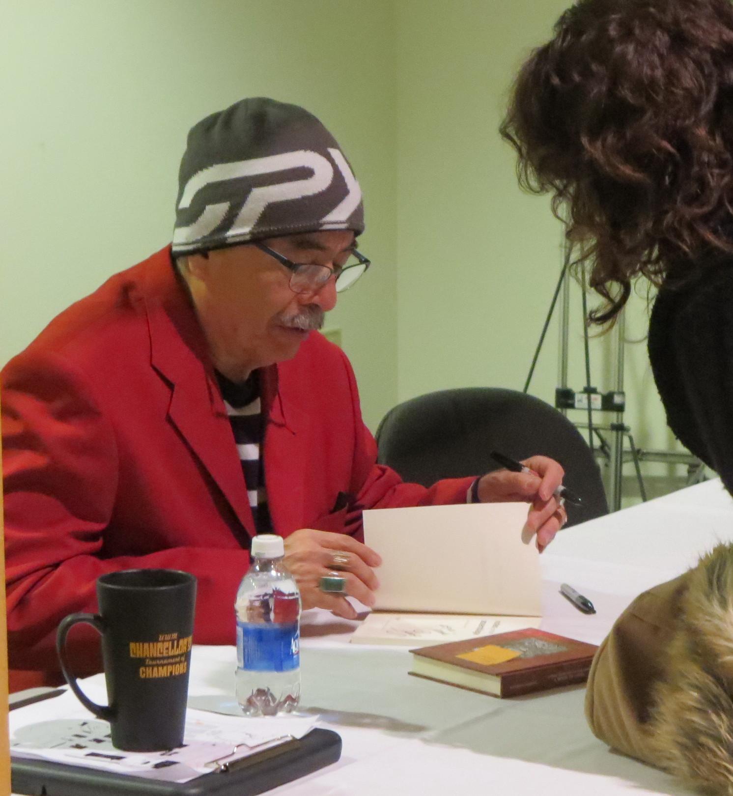 Juan Felipe Herrera, current Poet Laureate of the United States, signing book in Wisconsin.