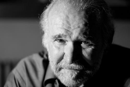 Poetry Spoken Here Host, Charlie Rossiter, caught contemplating deep poetic mysteries.