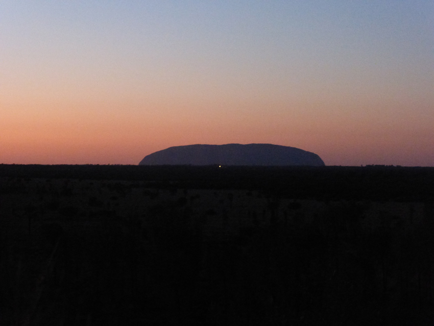 The most beautiful views of the rocks are at sunrise and sunset. This is Uluru (from a distance) at sunrise.