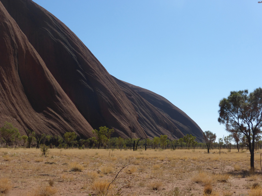 As our guide drove us toward the base of Uluru, he explained the spiritual and cultural significance of these two sacred places to the Anangu. During their 23,000 years - these were places of meeting, worship and ritual.