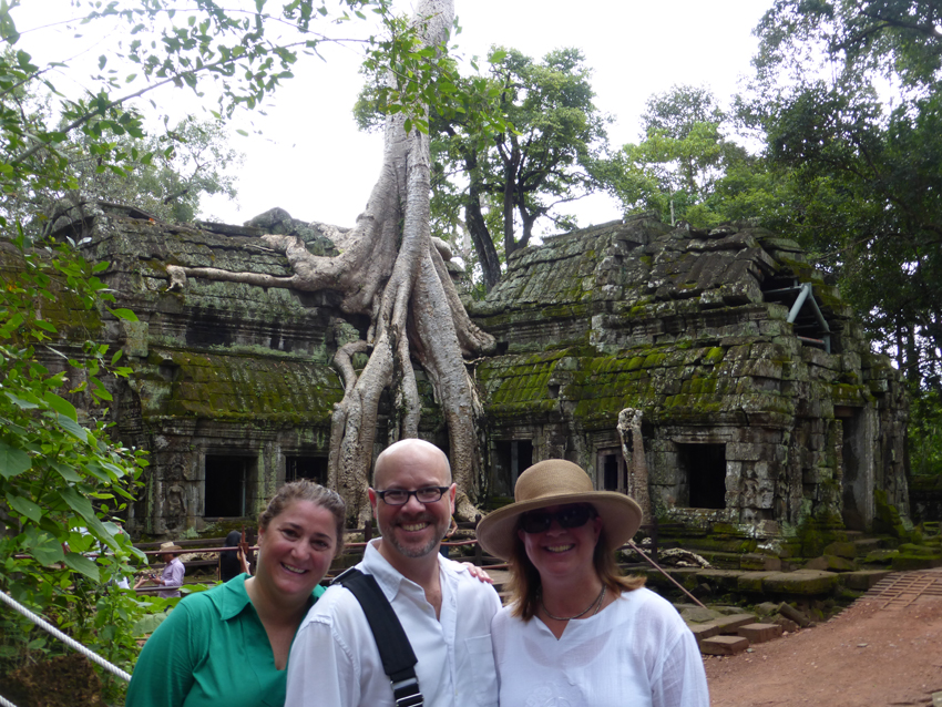 """Team SE Asia also went to Ta Prohm, a former monastic complex that is known for its jungle overgrowth. Trees literally """"consume"""" sections of the ruins. Restoration is underway, but it's clear that it will take a long time. Ta Prohm was made famous in modern times because it's where """"Lara Croft: Tomb Raider"""" was filmed."""