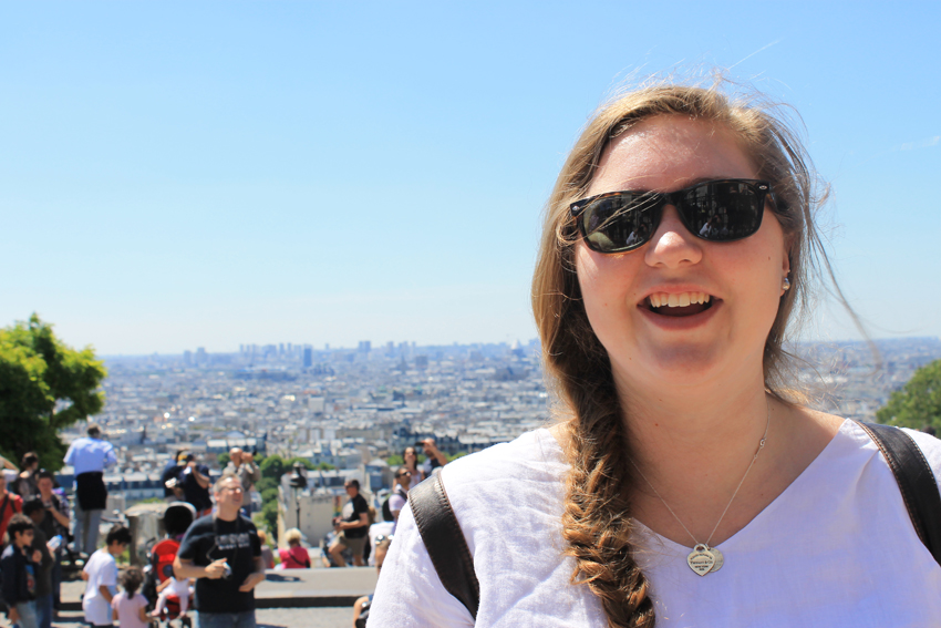 Annie at the entrance to Sacre-Coeur (Paris in the background)