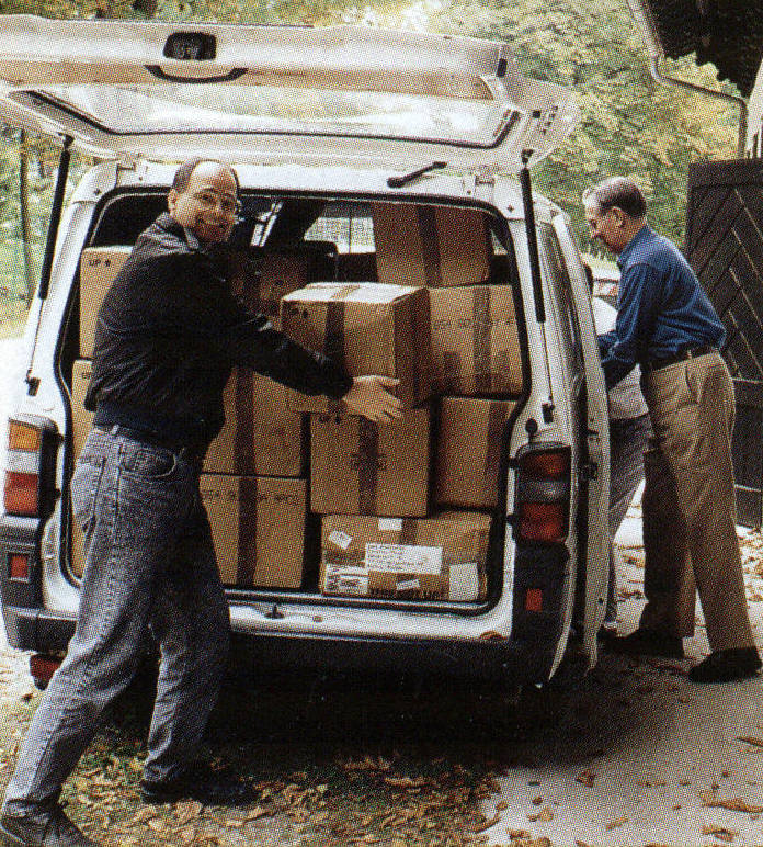 Tony Twist and Sam Stone unloading boxes of used clothing - 1994.jpg